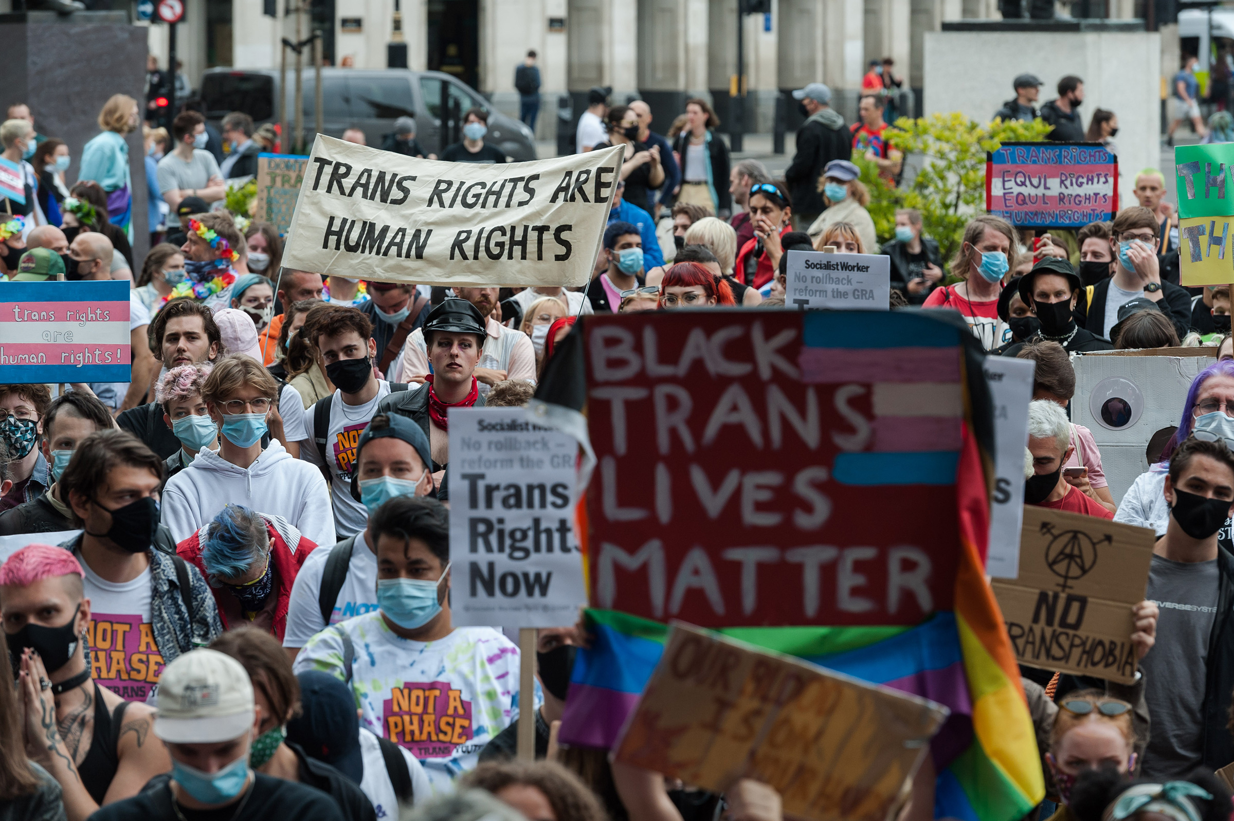 Transgender people and their supporters gather in Parliament Square to protest against potential changes to the Gender Recognition Act on July 4 in London