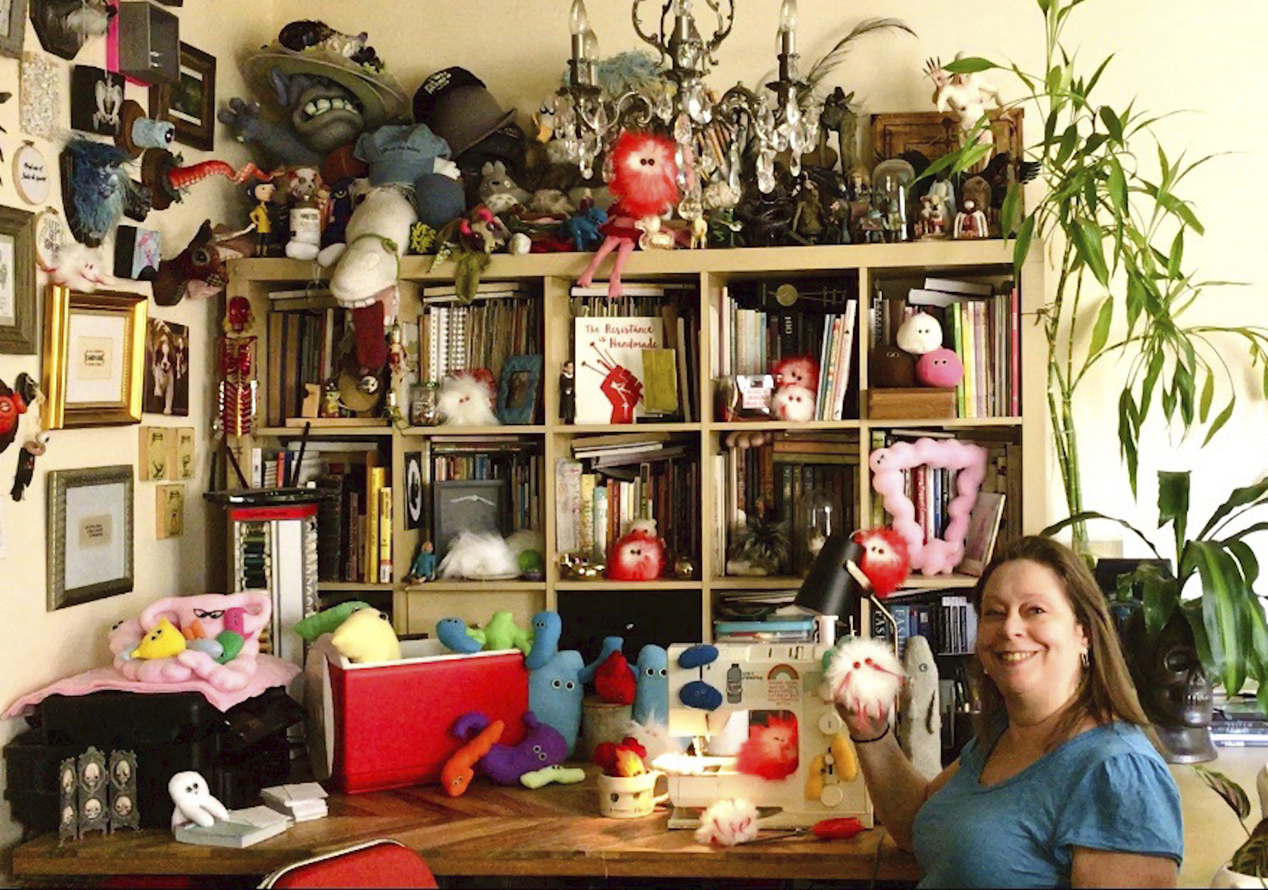 This July 25, 2020 photo shows Amy Micallef posing with her craft creations at her home. While Broadway stages remain dark due to the pandemic, Broadway workers are concentrating on side hustles.
