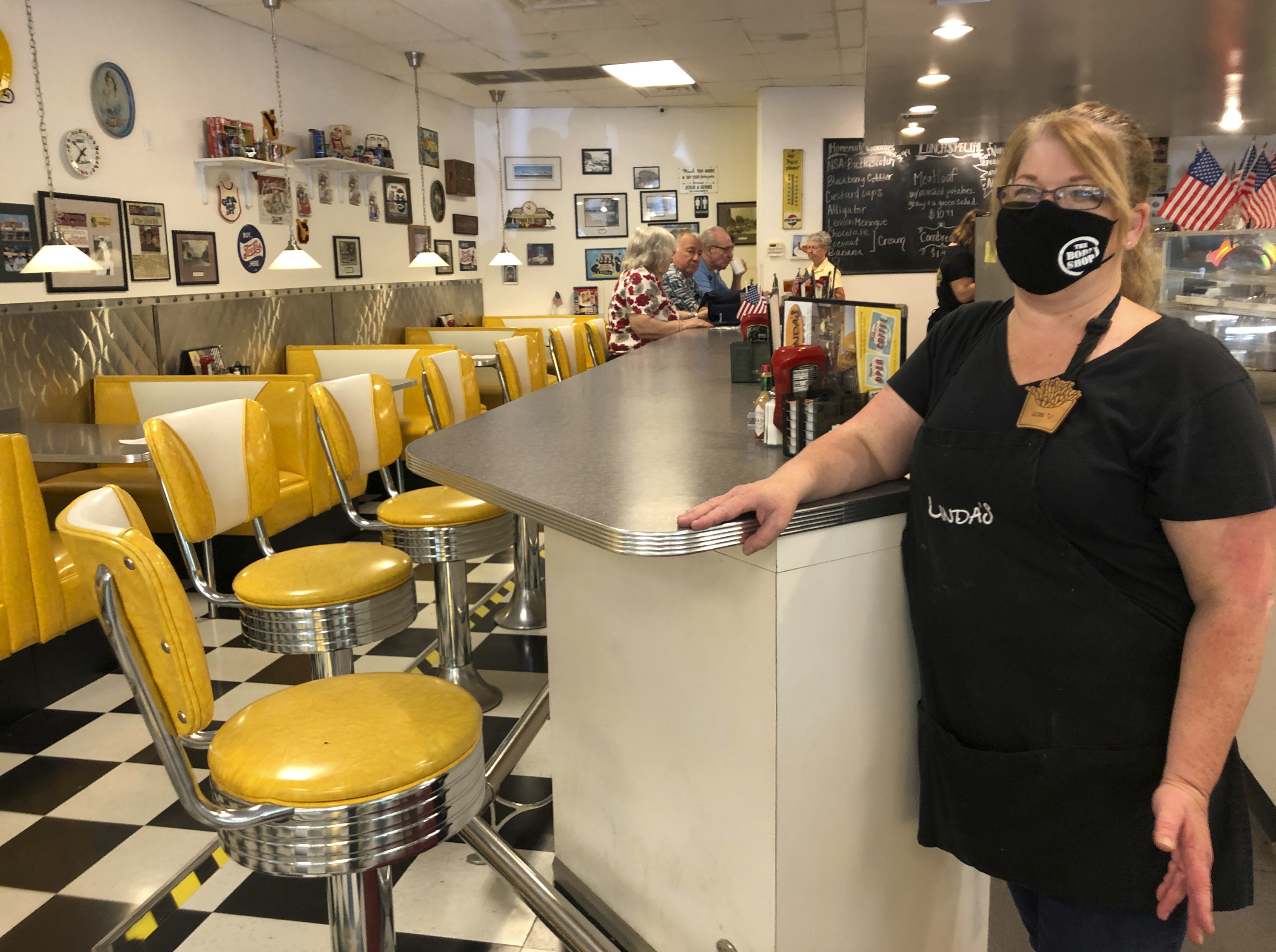 Restaurant manager Lori Pack stands at the counter of Linda's Soda Bar and Grill in Yuba City, Calif., July 9, 2020.