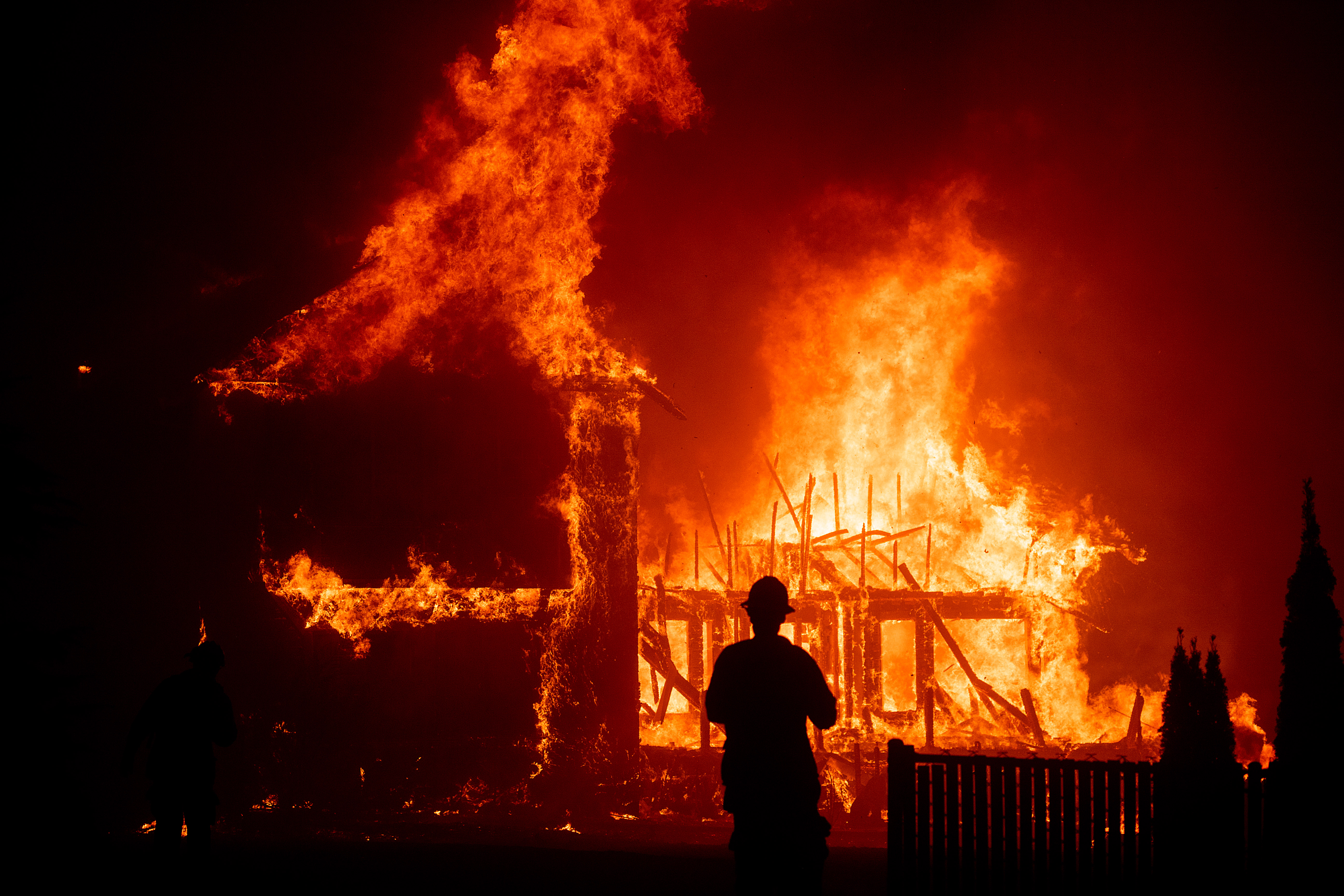 A home burns as the Camp Fire rages through Paradise, CA on Thursday, Nov. 8, 2018.