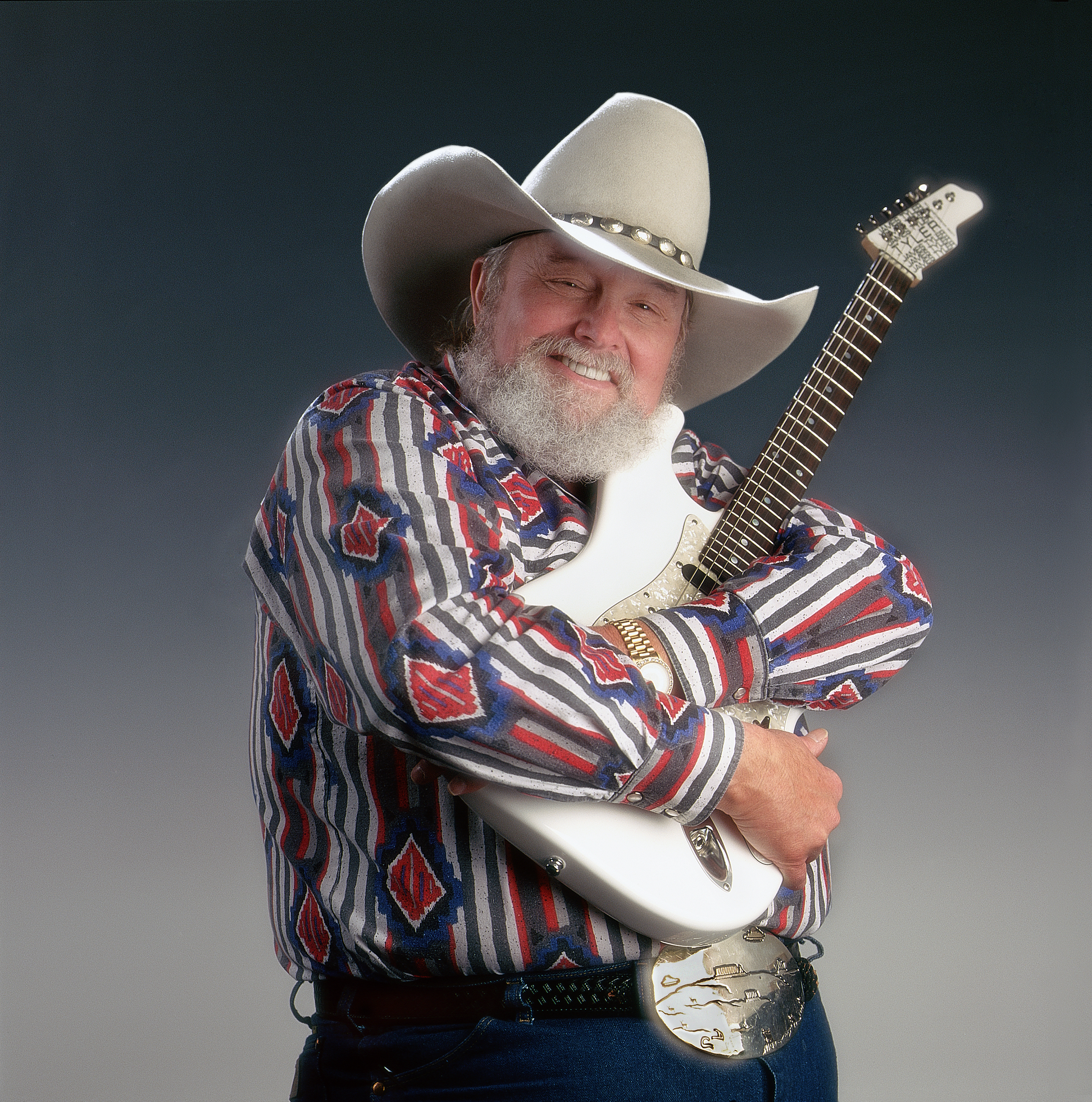 American country and bluegrass musician Charlie Daniels with his guitar during a 1997 photo shoot in Wilmington, North Carolina.