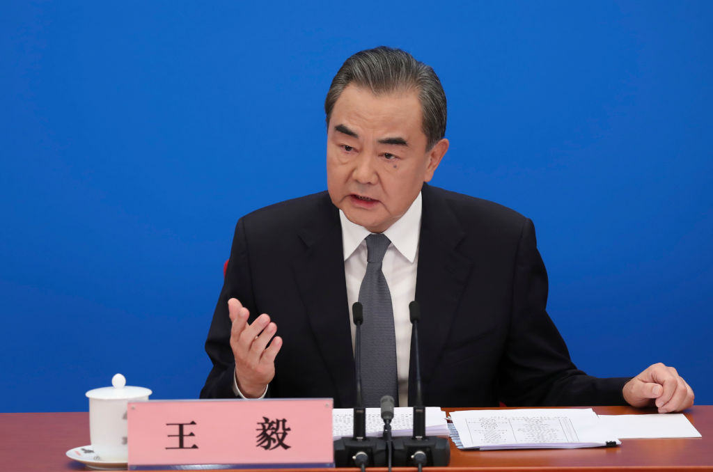 Chinese State Councilor and Foreign Minister Wang Yi attends a press conference at the Great Hall of the People via video link in Beijing, China on May 24, 2020.