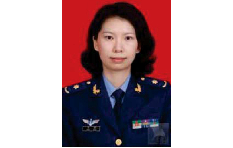 This undated photo provided by the U.S. Justice Department shows Juan Tang in her China People's Liberation Army military uniform.