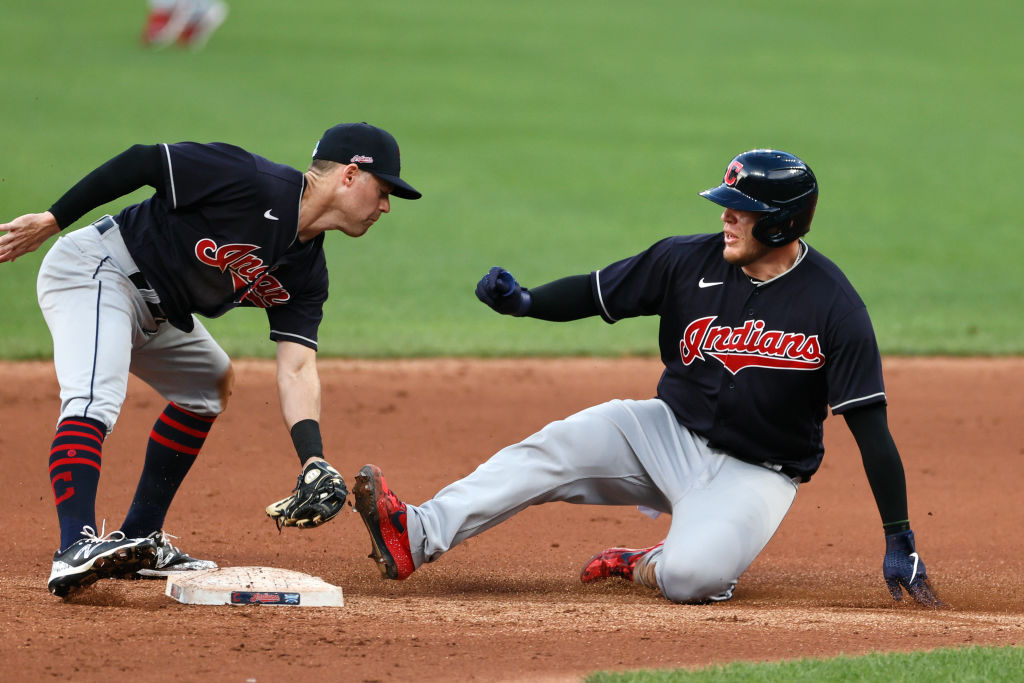 Roberto Perez #55 of the Cleveland Indians slides safely into second base as Jake Elmore #13 covers in the fifth inning of an intra-squad game during summer workouts at Progressive Field on July 12, 2020 in Cleveland, Ohio.