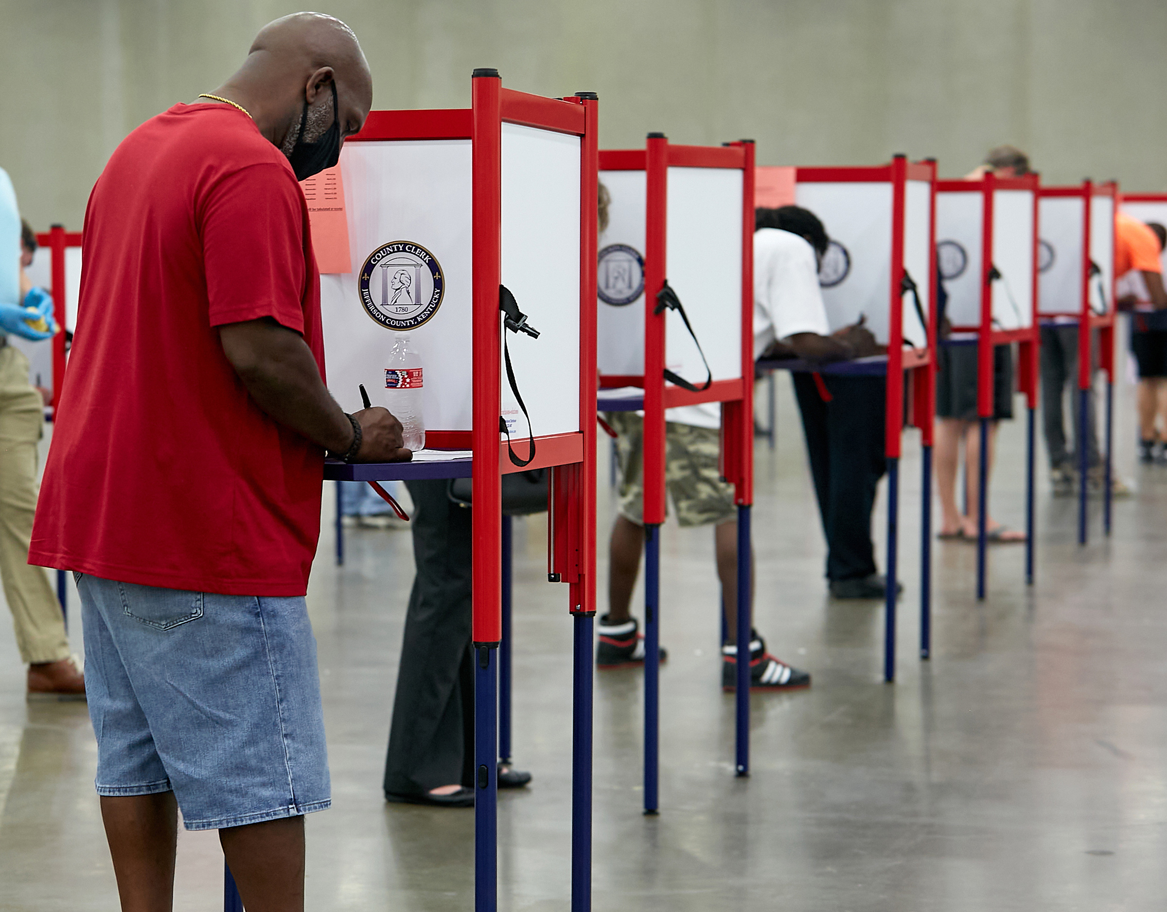 Primary voters cast their ballots at a polling place in Louisville, Ky., on June 23