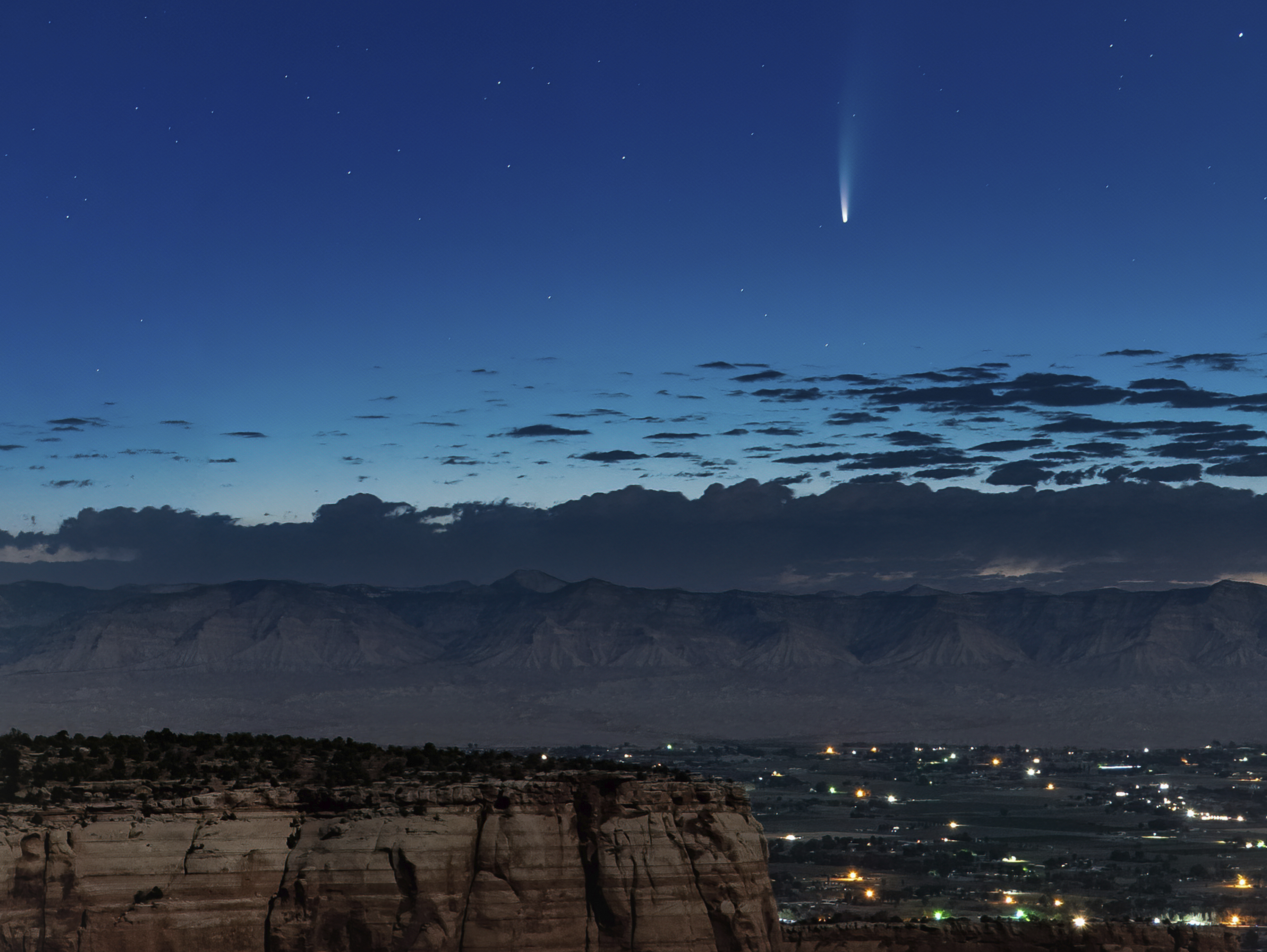 Comet Neowise soars in the horizon of the early morning sky in this view from the near the grand view lookout at the Colorado National Monument west of Grand Junction, Colo., on July 9, 2020.