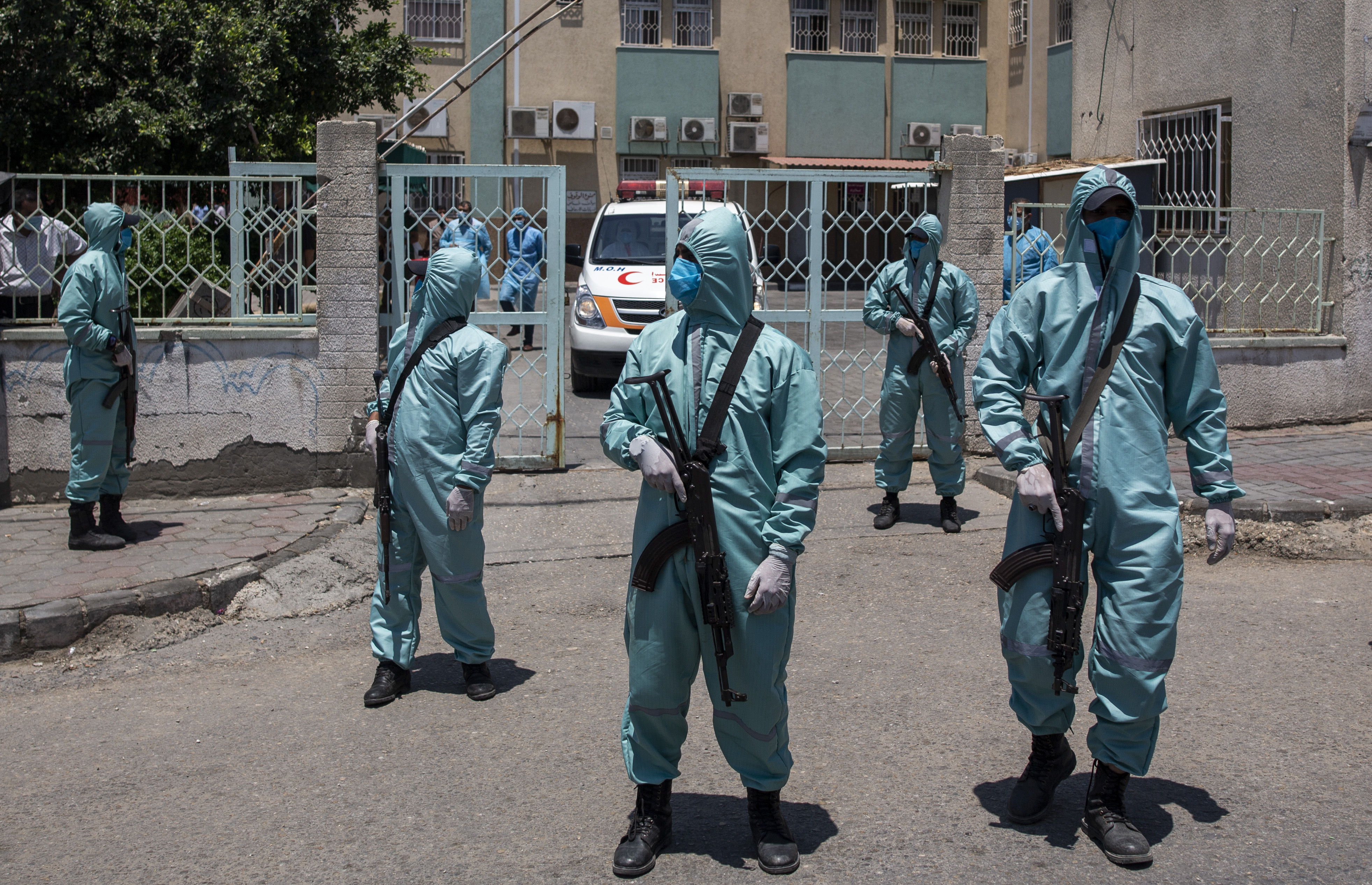 Palestinian Hamas police officers wear protective suits as they take part in a simulation of possible coronavirus infections in Gaza City, on July 18, 2020.