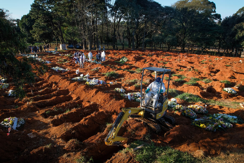 An excavator digs graves at the Vila Formosa cemetery in the middle of the coronavirus pandemic in Sao Paulo, Brazil.