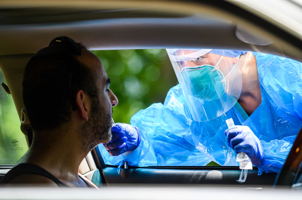 A health worker performs a COVID-19 nasal swab test in New York City on July 29, 2020.