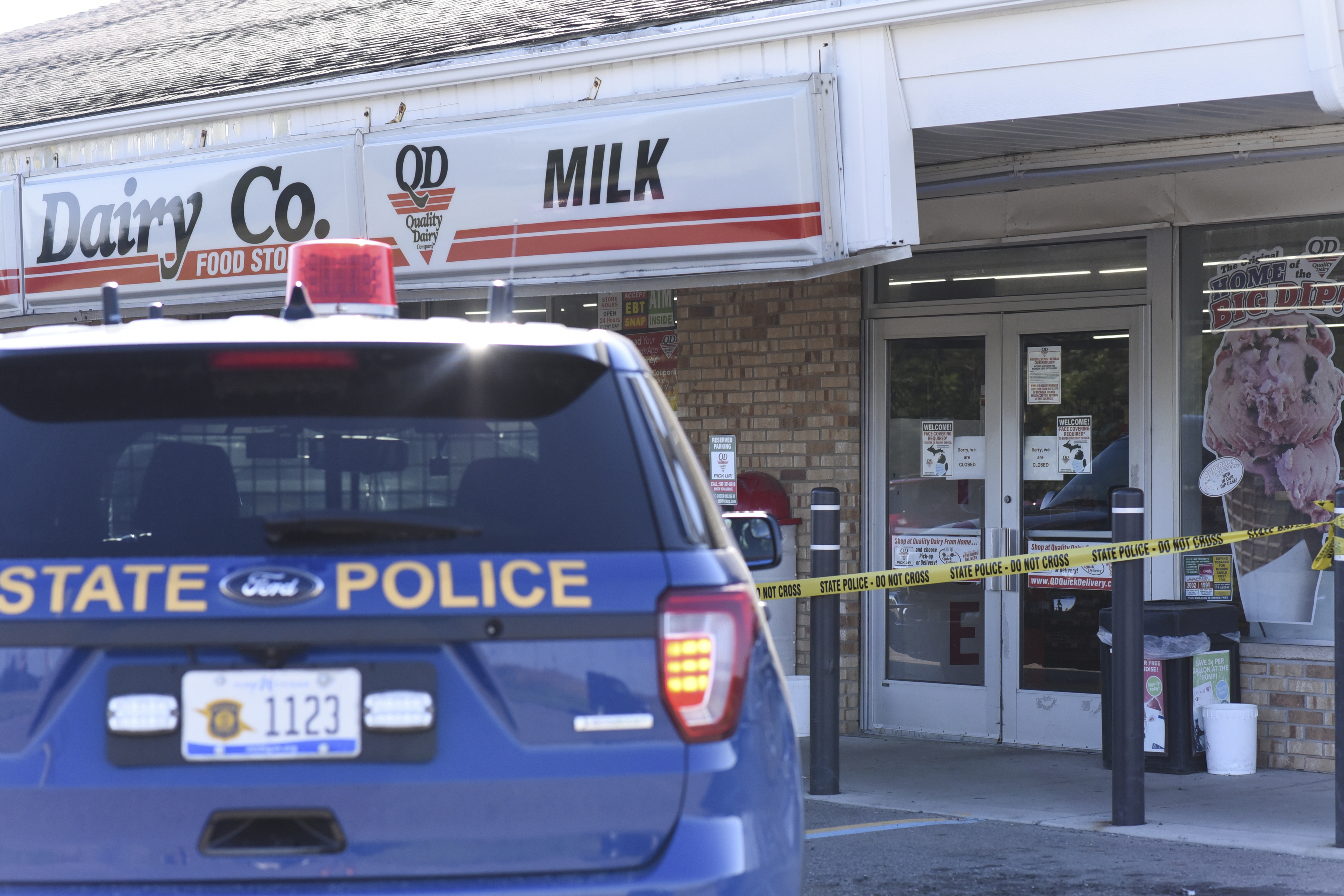 The scene where a 77-year-old man was allegedly stabbed by a 43-year-old man, July 14, 2020, outside of a Quality Dairy on Lansing Road in Windsor Township, Michigan.