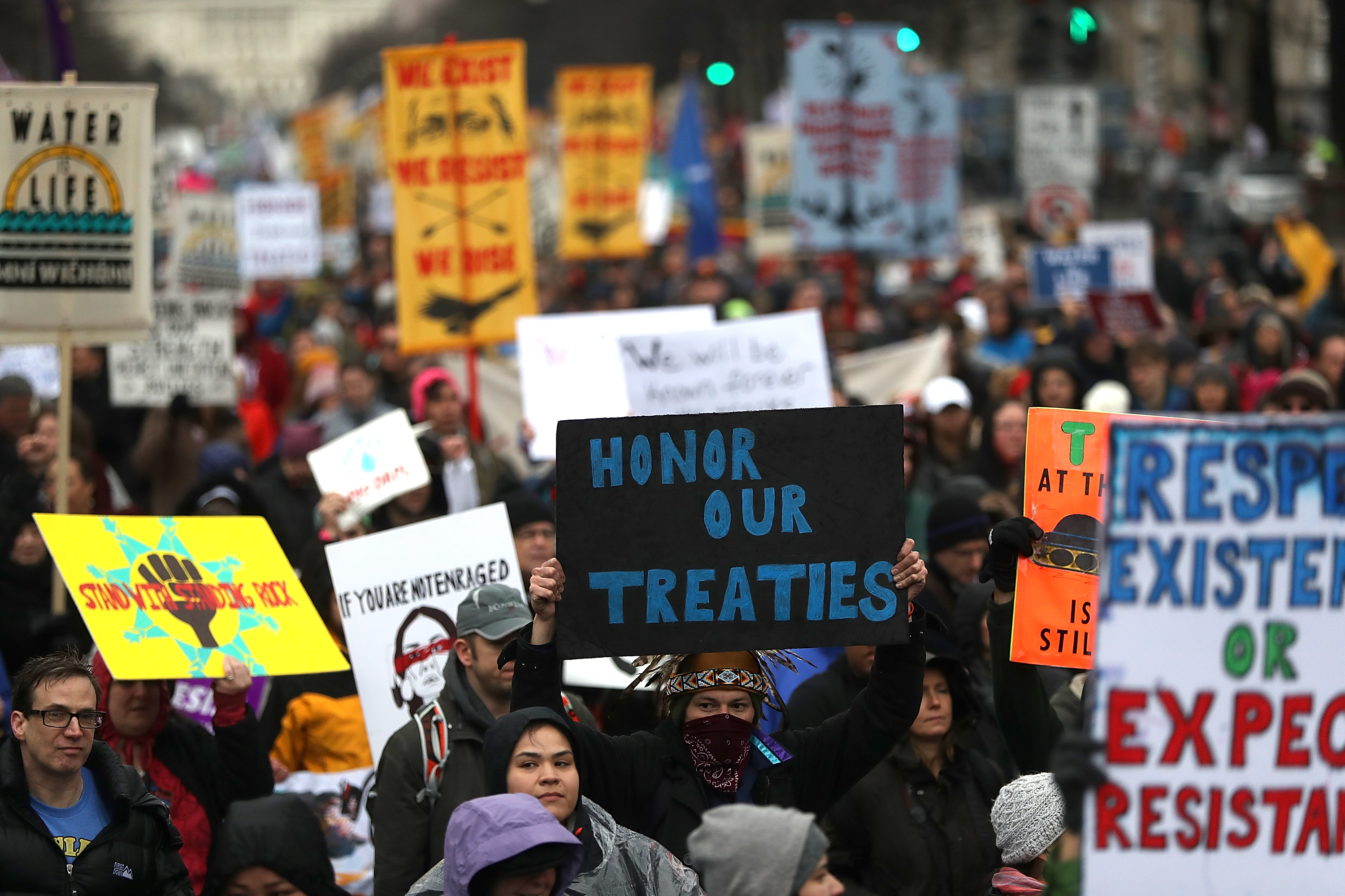 Protesters march during a demonstration against the Dakota Access Pipeline on March 10, 2017 in Washington, D.C.