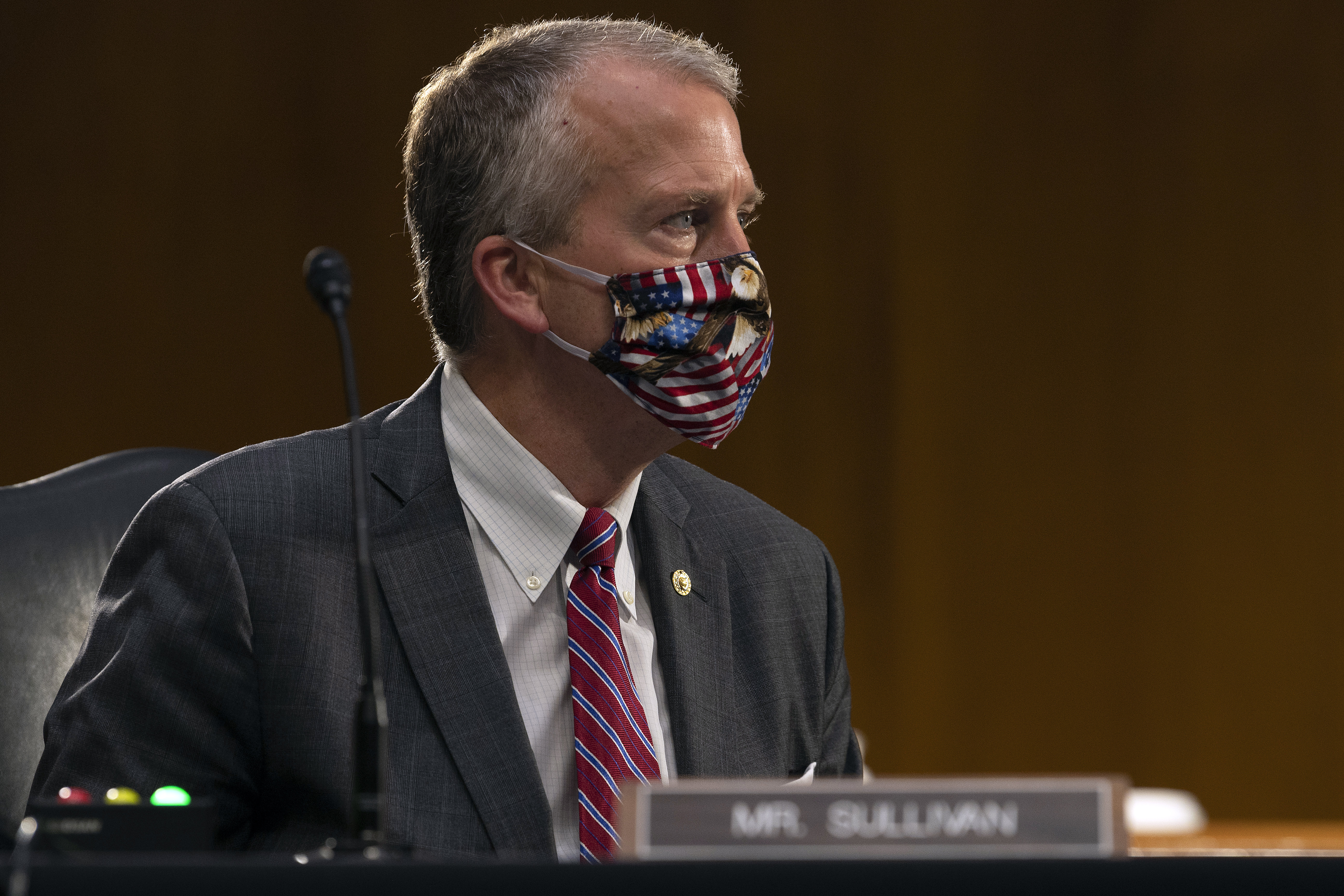 Sen. Dan Sullivan, R-Alaska, listens during a Senate Committee on Commerce, Science and Transportation hearing on  The State of the Aviation Industry: Examining the Impact of the COVID-19 Pandemic  on Capitol Hill in Washington, Wednesday, May 6, 2020.