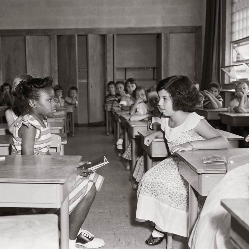 Two students in Fort Myer Elementary School face each other on the first day of desegregation in 1954.