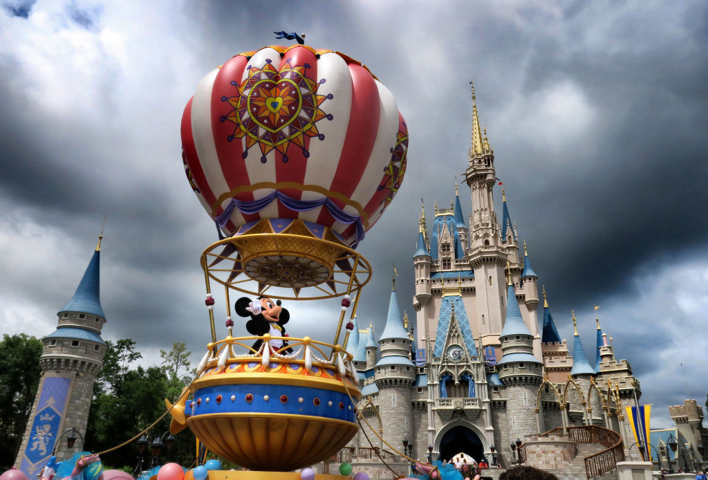 Mickey and Minnie appear under stormy skies during the afternoon parade, shortly before the Magic Kingdom at Walt Disney World in Lake Buena Vista, Fla., closed early due to weather spawned by Hurricane Dorian, Tuesday, Sept. 3, 2019.