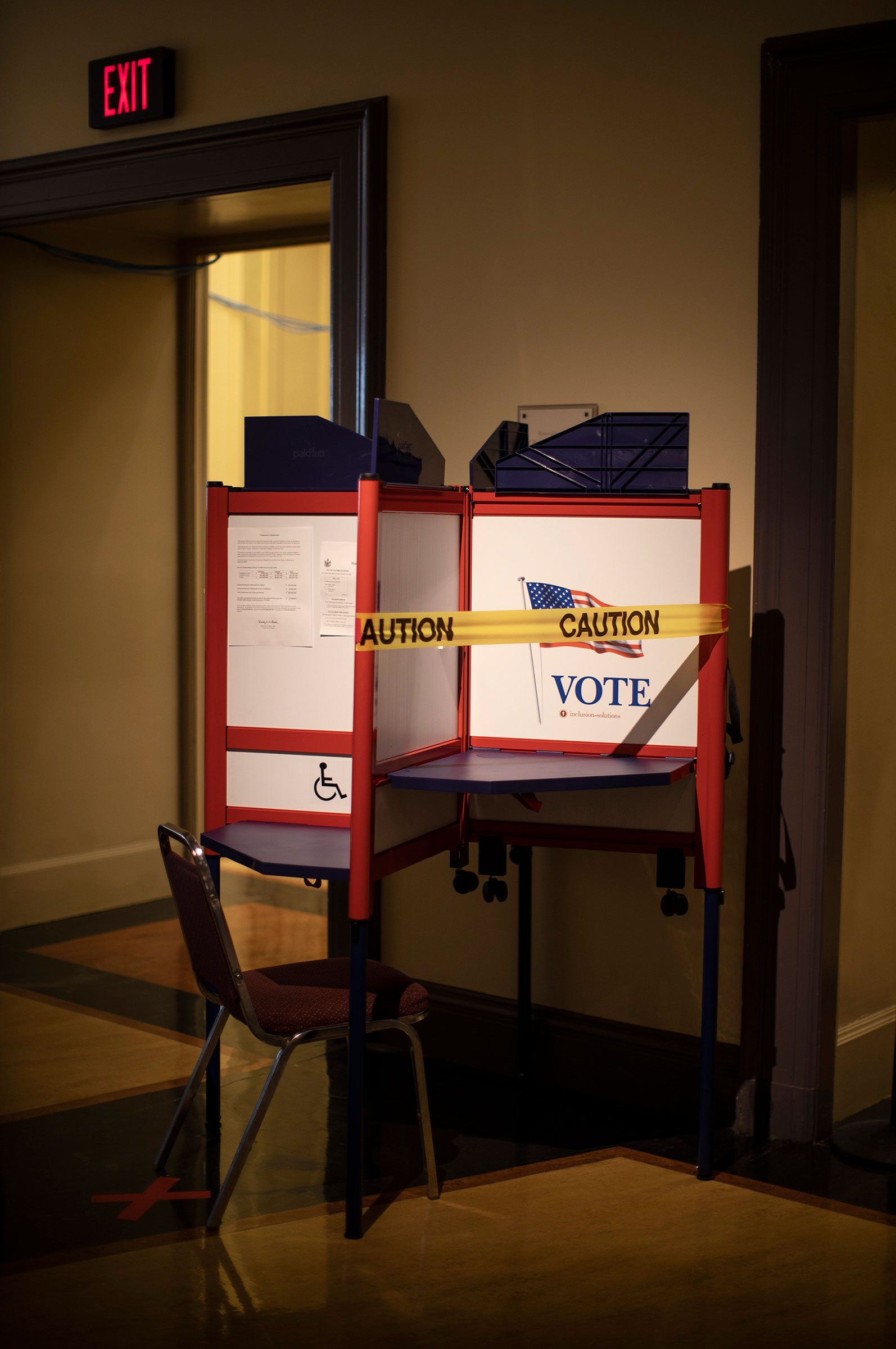 A voting booth is taped off to ensure social distancing during in-person absentee voting in Portland on June 23, 2020.
