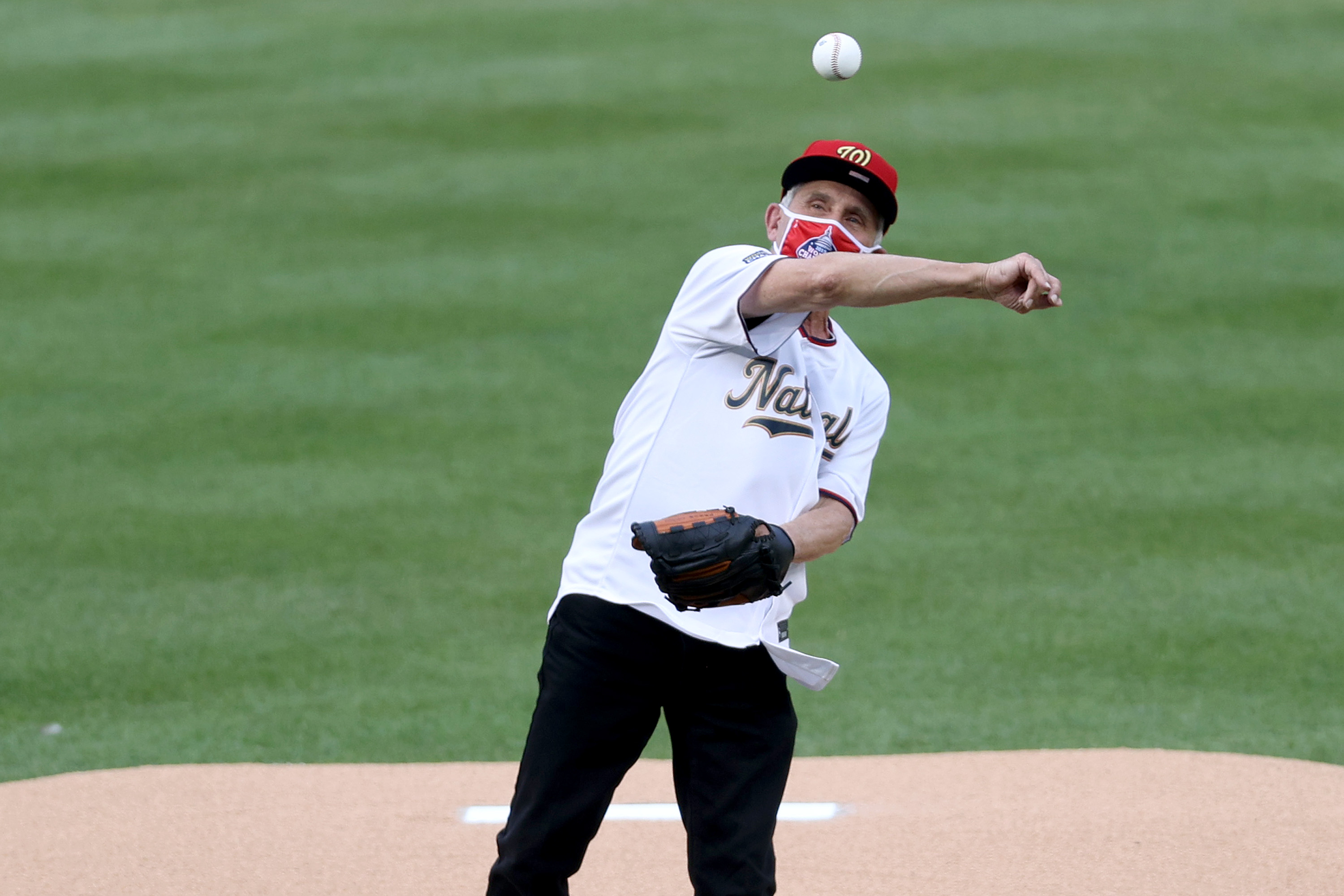 Dr. Anthony Fauci throws out the ceremonial first pitch prior to the game between the New York Yankees and the Washington Nationals at on July 23, 2020 in Washington, D.C.
