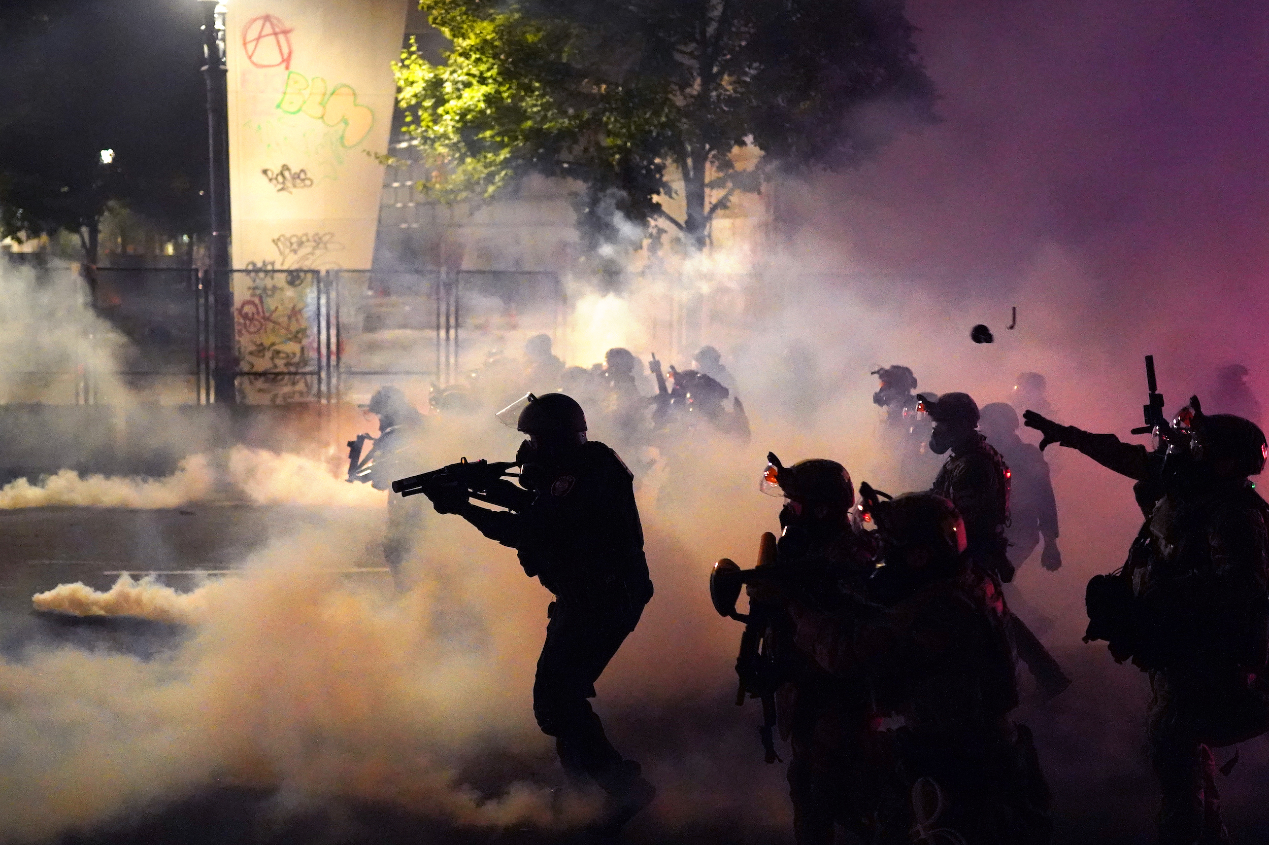 Federal officers deploy tear gas and less-lethal munitions while dispersing a crowd of about a thousand protesters in front of the Mark O. Hatfield U.S. Courthouse on July 24, 2020 in Portland, Oregon.