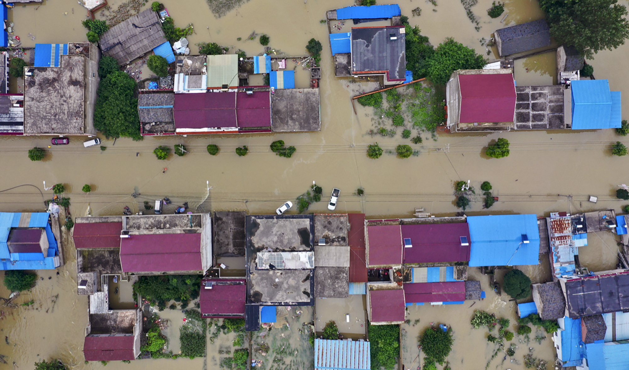 In this photo released by Xinhua News Agency, an aerial photo shows the extent of flooding in Guzhen Town of Lu'an City in eastern China's Anhui Province on July 20, 2020.