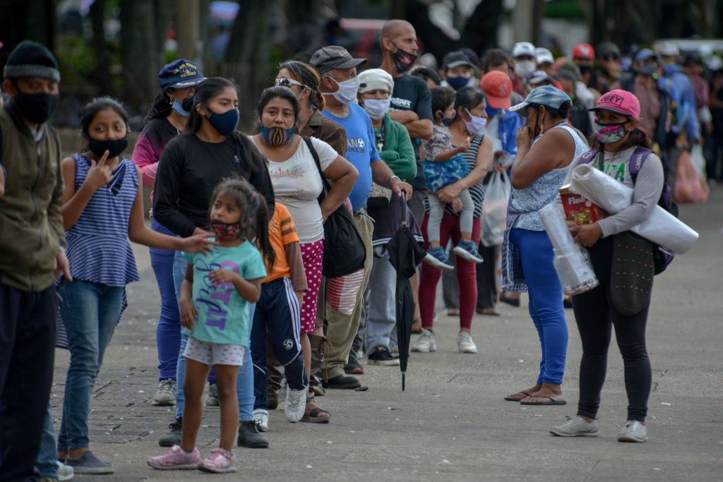 Hundreds of Guatemalans line up on July 2nd in the central square in Guatemala City, Guatemala for the food delivery. The youth collective ''olla comunitaria'' during the pandemic receives a donation for the preparation of food during the pandemic that affects the country.