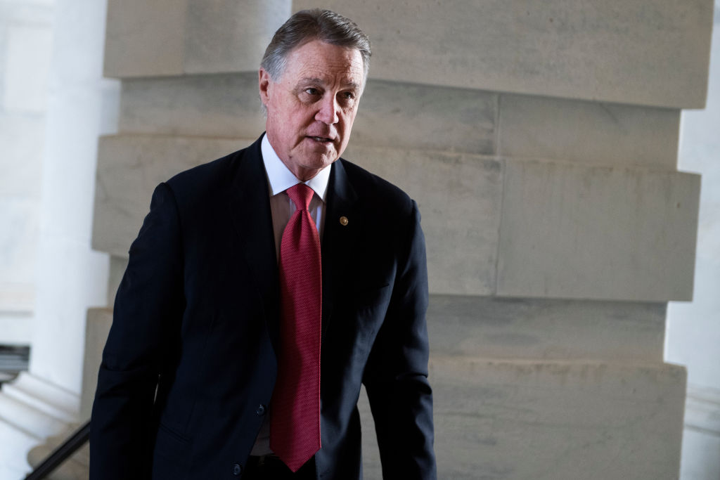 Georgia Sen. David Perdue arrives to the Senate carriage entrance of the Capitol on Wednesday, Jan. 29, 2020.