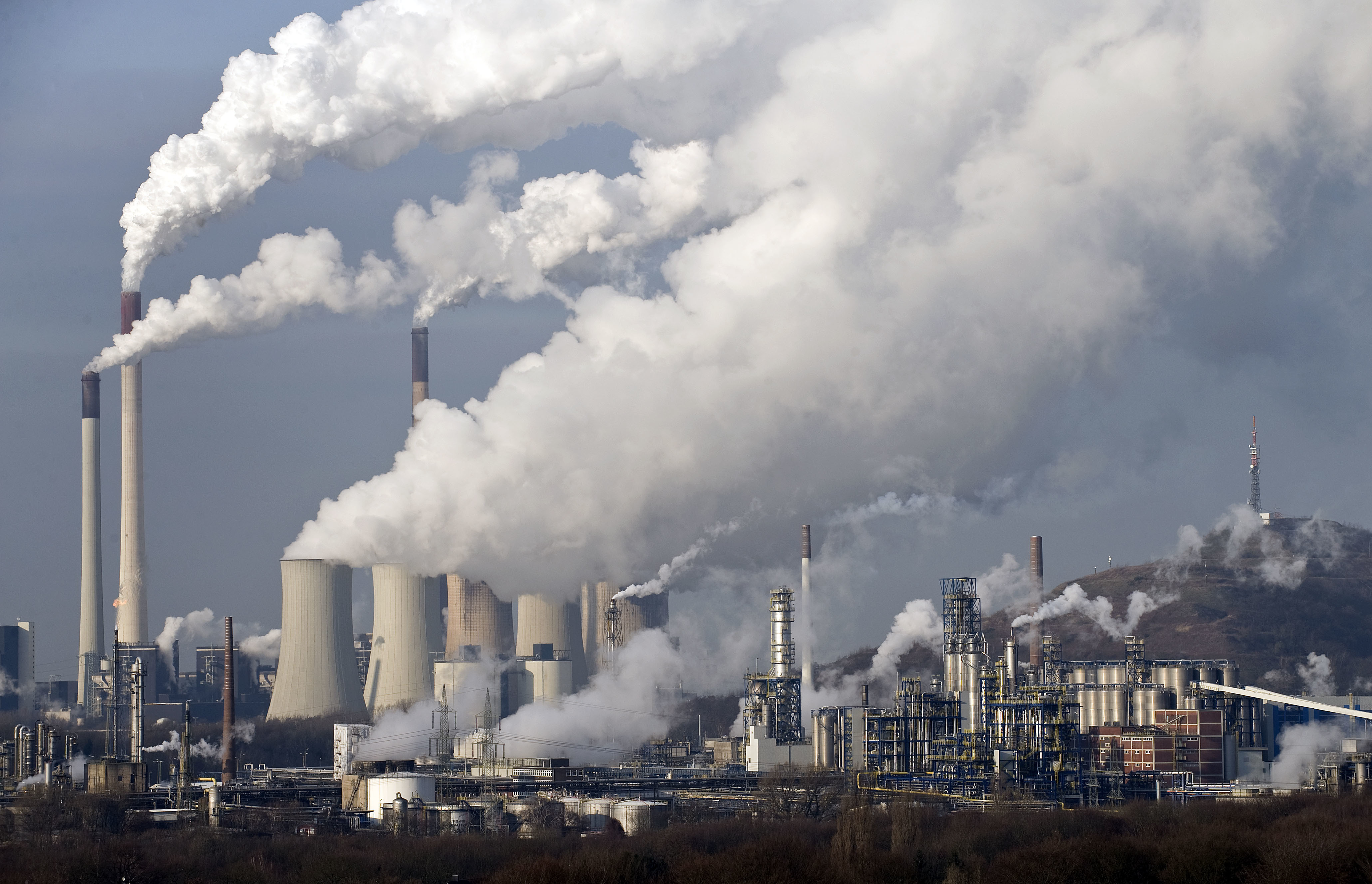 FILE - In this Dec. 16, 2009 file photo, steam and smoke rise from a coal burning power plant in Gelsenkirchen, Germany. The state governors Dietmar Woidke of Brandenburg, Michael Kretschmer of Saxony, Reiner Haseloff of Saxony-Anhalt and Armin Laschet of North Rhine-Westphalia meet in Berlin for the adoption by the Bundestag and Bundesrat of the laws on coal phase-out and structural strengthening in the affected federal states.
