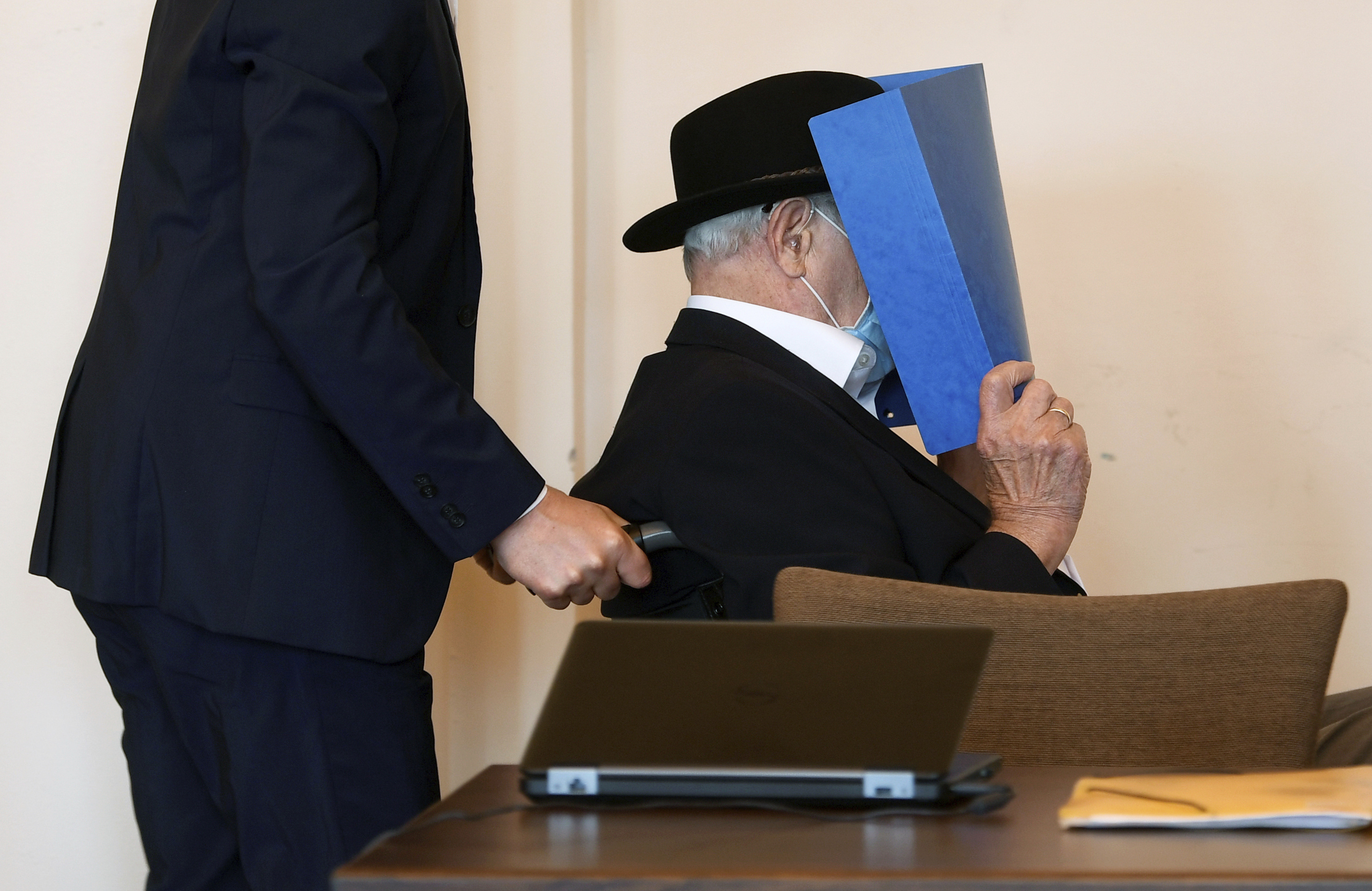 The 93-year-old German Bruno Dey, accused of being an SS guard involved in killing thousands of prisoners, arrives at a Hamburg court room on July 23, 2020.