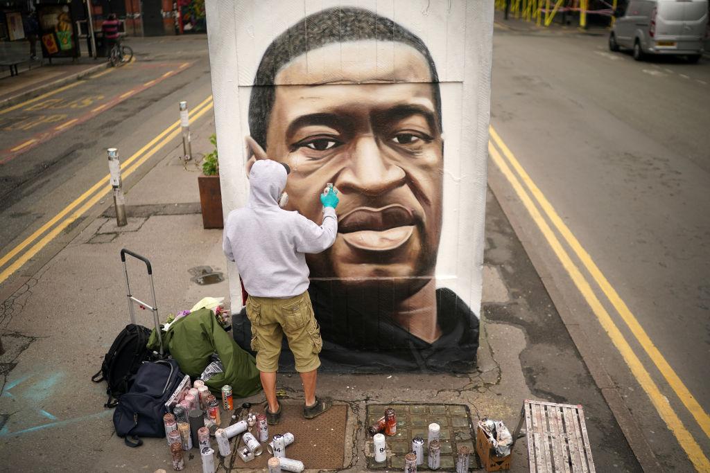 Graffiti artist Akse spray paints a mural of George Floyd in Manchester, U.K. on June 3, 2020.