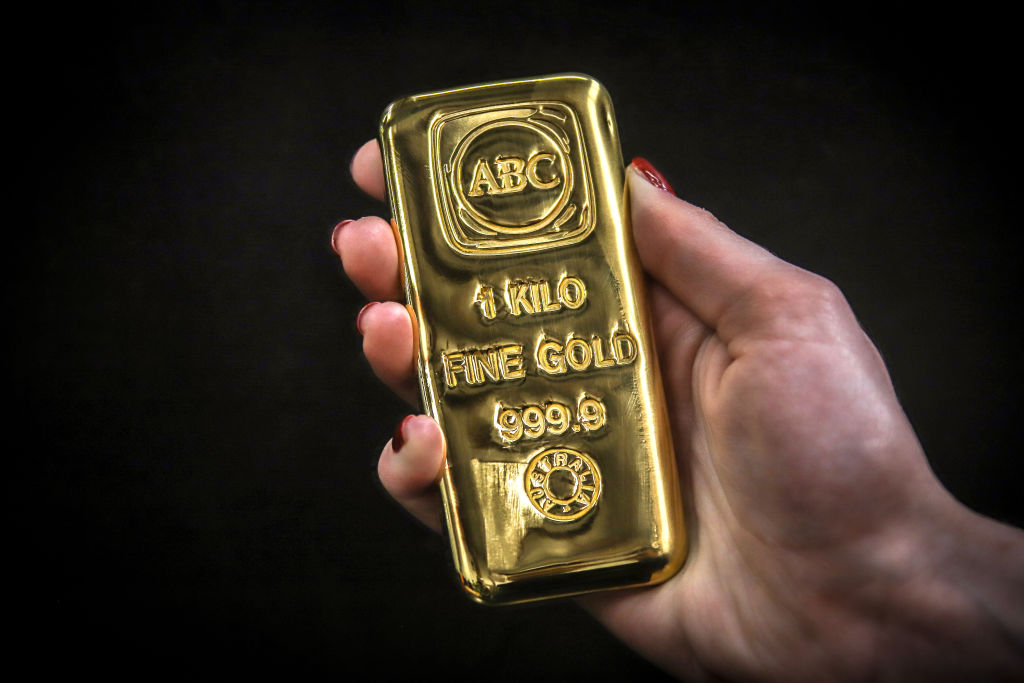 A person holds an ABC Bullion one kilogram gold bar at the ABC Refinery smelter in Sydney, New South Wales, Australia, on Thursday, July 2, 2020. Western investors piling into gold in the pandemic are more than making up for a collapse in demand for physical metal from traditional retail buyers in China and India, helping push prices to an eight-year high.