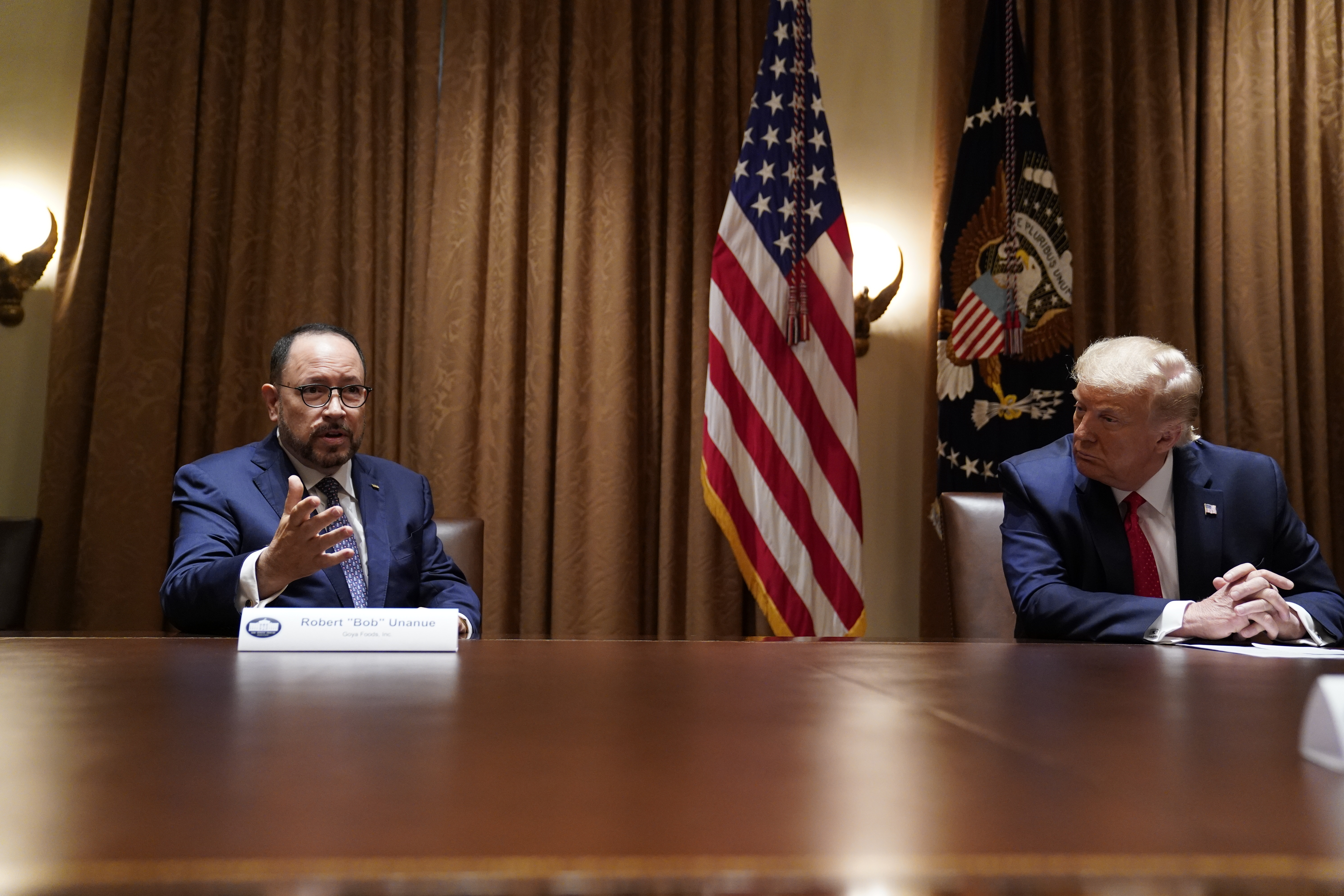 President Donald Trump listens as Robert Unanue, of Goya Foods, speaks during a roundtable meeting with Hispanic leaders in the Cabinet Room on July 9, 2020, in Washington.
