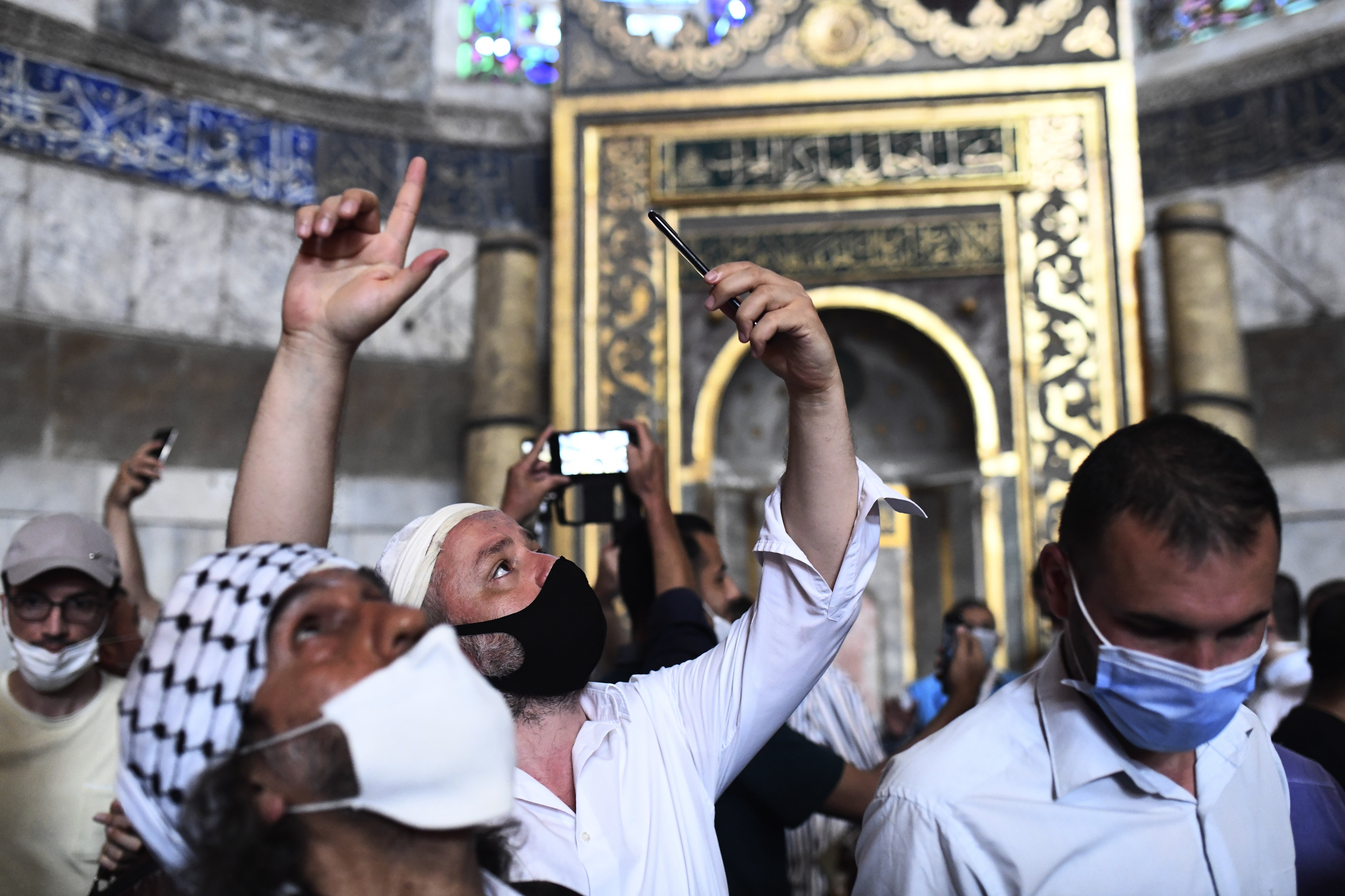 People use their mobile phones to take pictures inside the Hagia Sophia July 24, 2020.