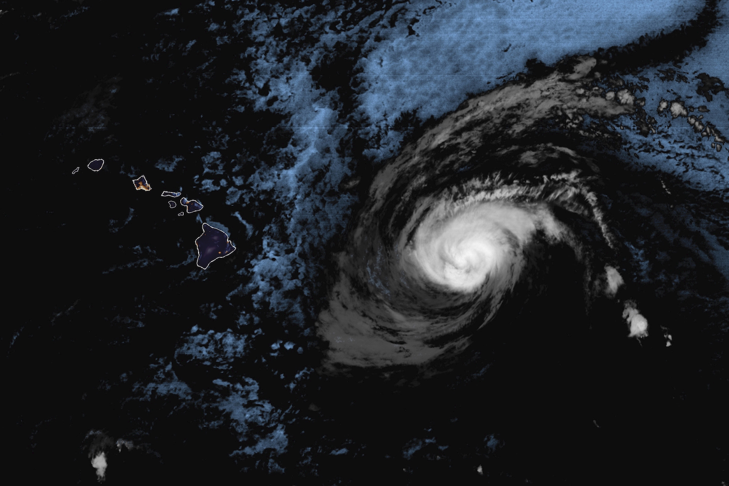 This Saturday, July 25, 2020 infrared satellite image made available by the National Oceanic and Atmospheric Administration shows Hurricane Douglas approximately 500 miles east of Hawaii at 4:10 a.m. HST.