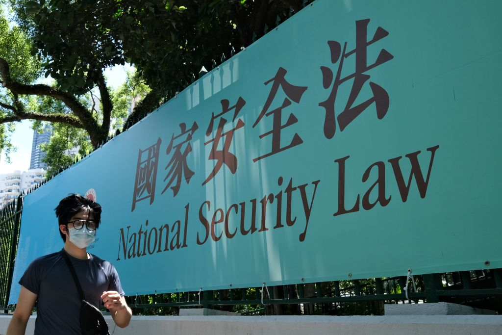 A man walks past a public notice banner for the National Security Law in Hong Kong on July 15, 2020.