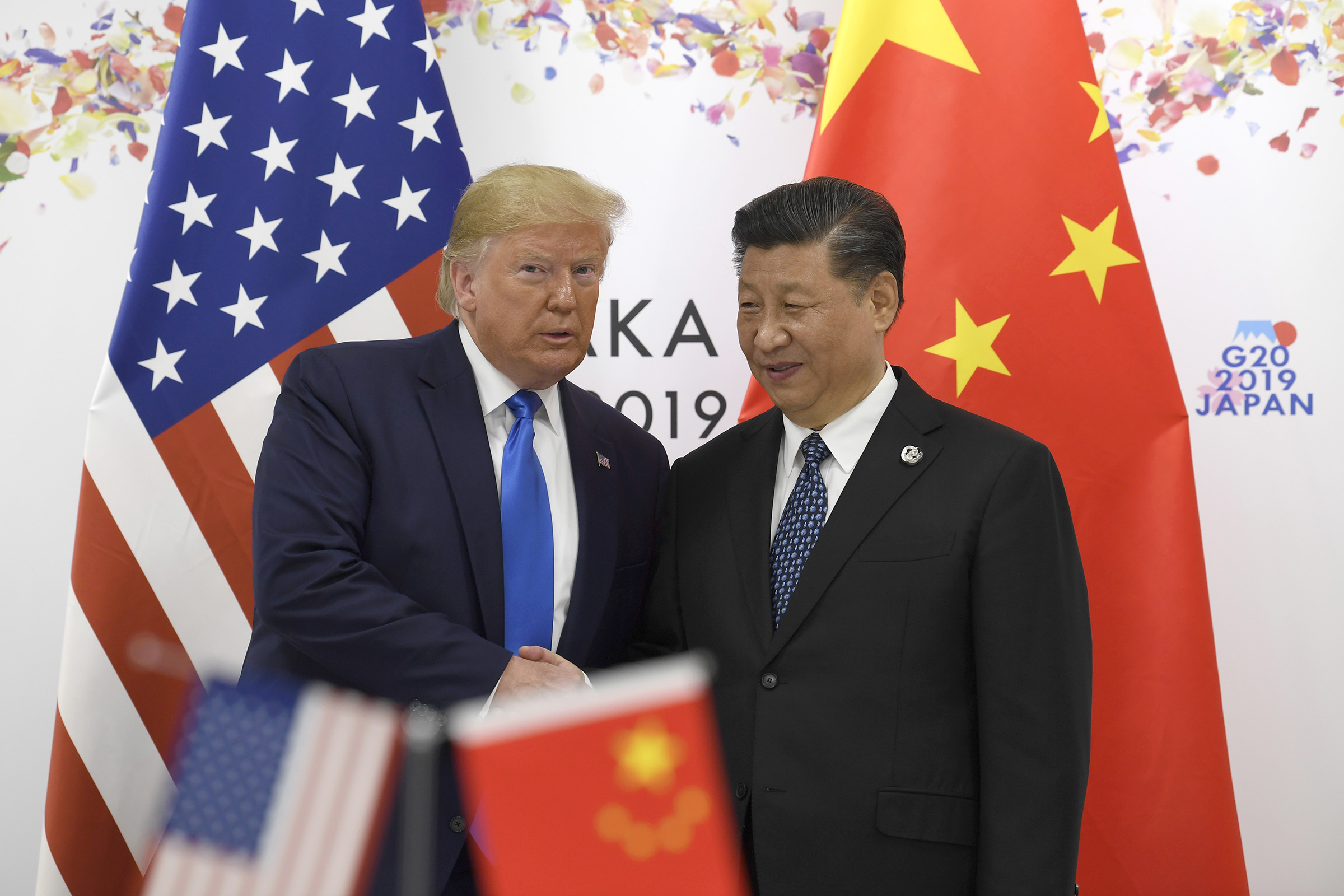 President Donald Trump poses for a photo with Chinese President Xi Jinping during a meeting on the sidelines of the G-20 summit in Osaka, Japan, on June 29, 2019.
