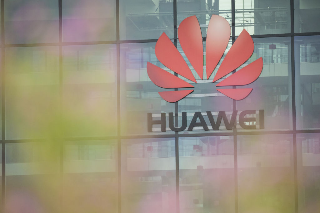 A Huawei Technologies Co. logo hangs above the entrance to the company's offices in Reading, U.K., on Monday, July 13, 2020.