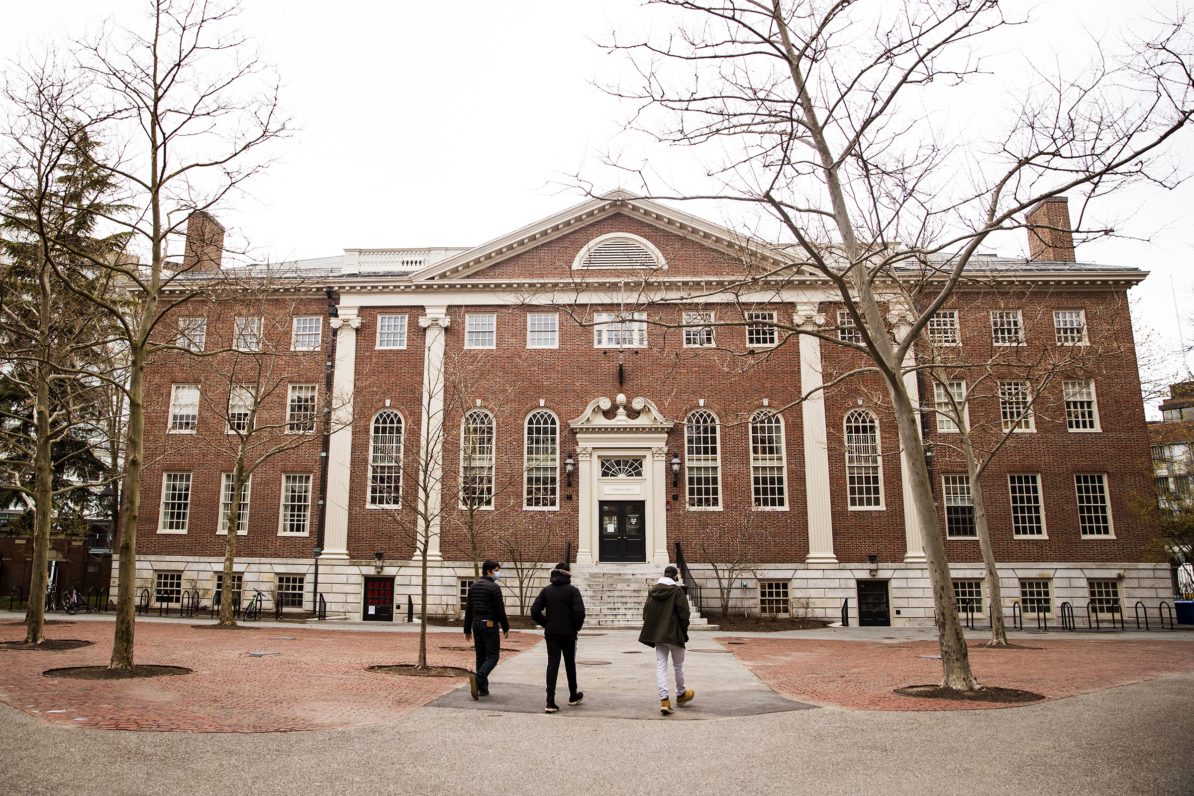 Pedestrians walk through Harvard Yard on the closed Harvard University campus in Cambridge, Massachusetts, U.S., on April 20, 2020.