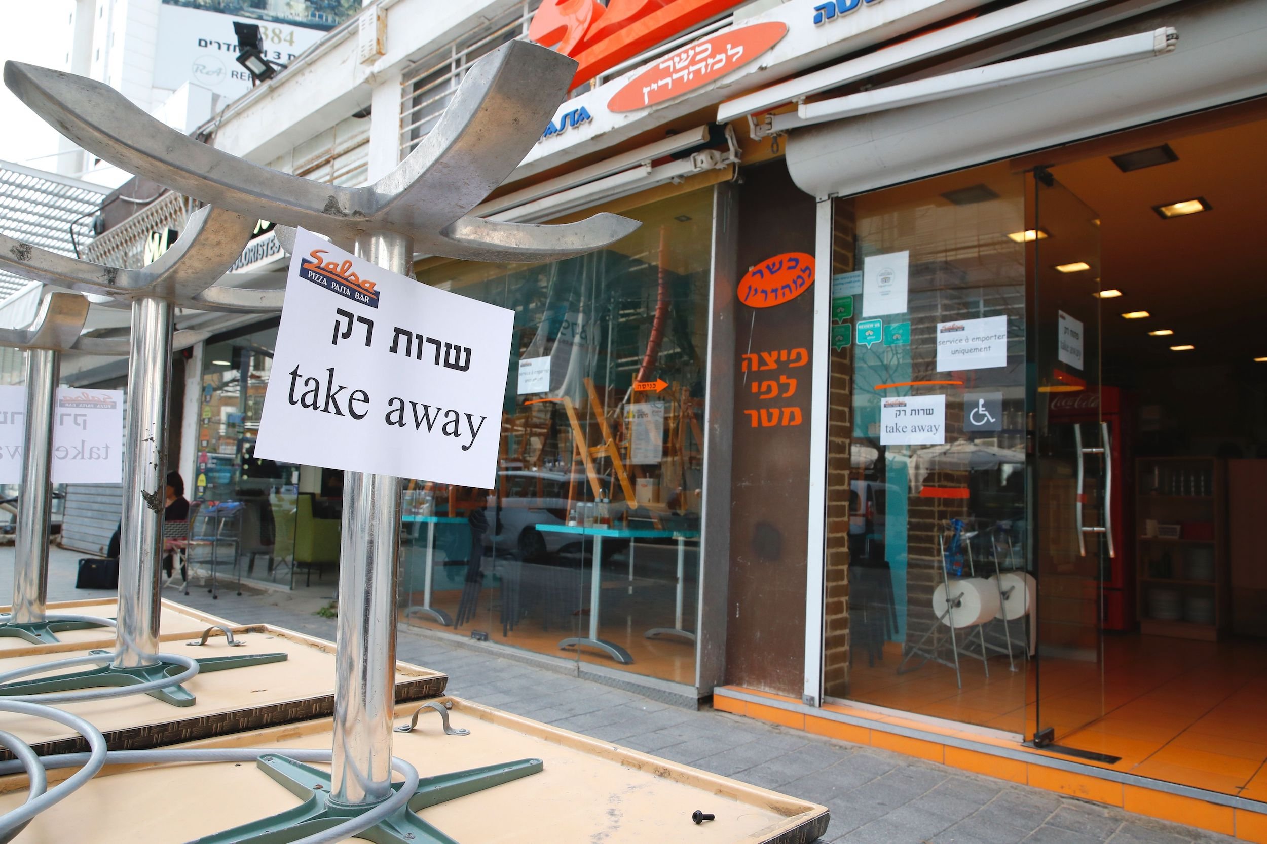 In the central coastal city of Netanya shows a shop serving only take-away after Israel shut down eateries, shopping centres and gyms in a bid to halt the spread of novel coronavirus on March 15, 2020.