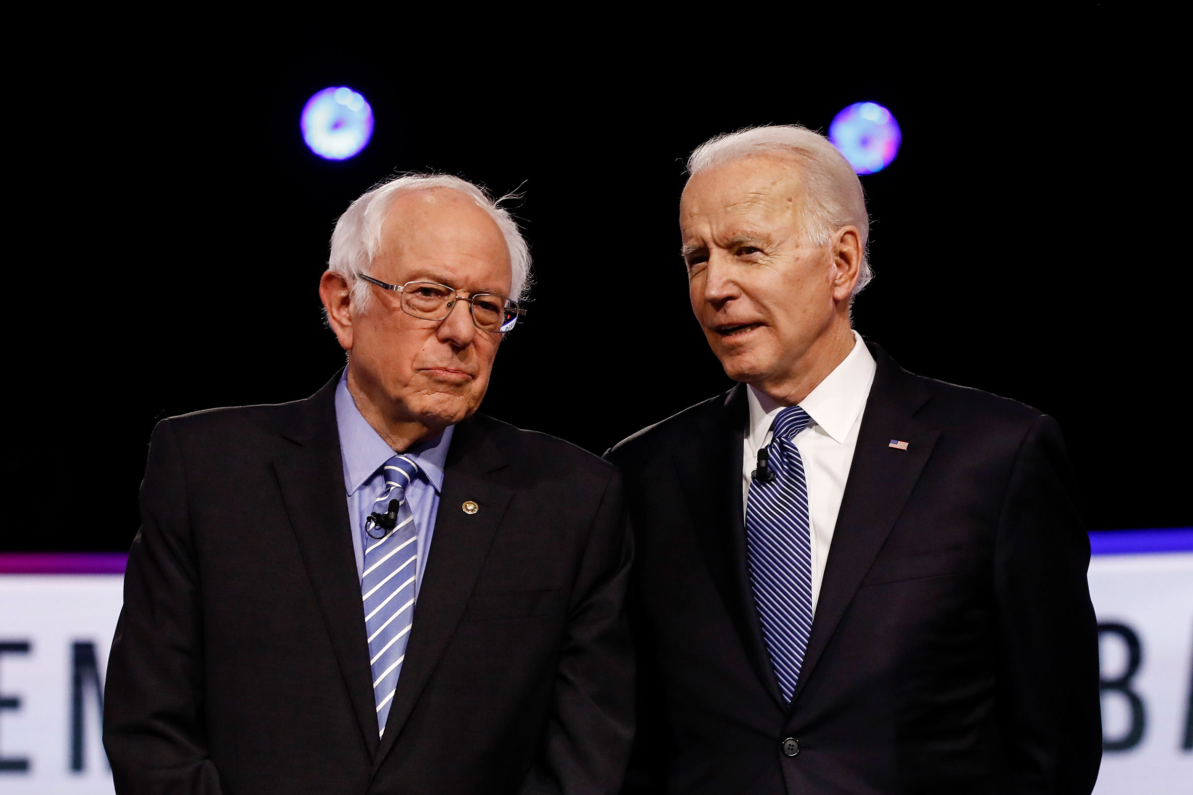 Sen. Bernie Sanders and former Vice President Joe Biden, before a Democratic presidential primary debate in Charleston, S.C. on Feb. 25, 2020.