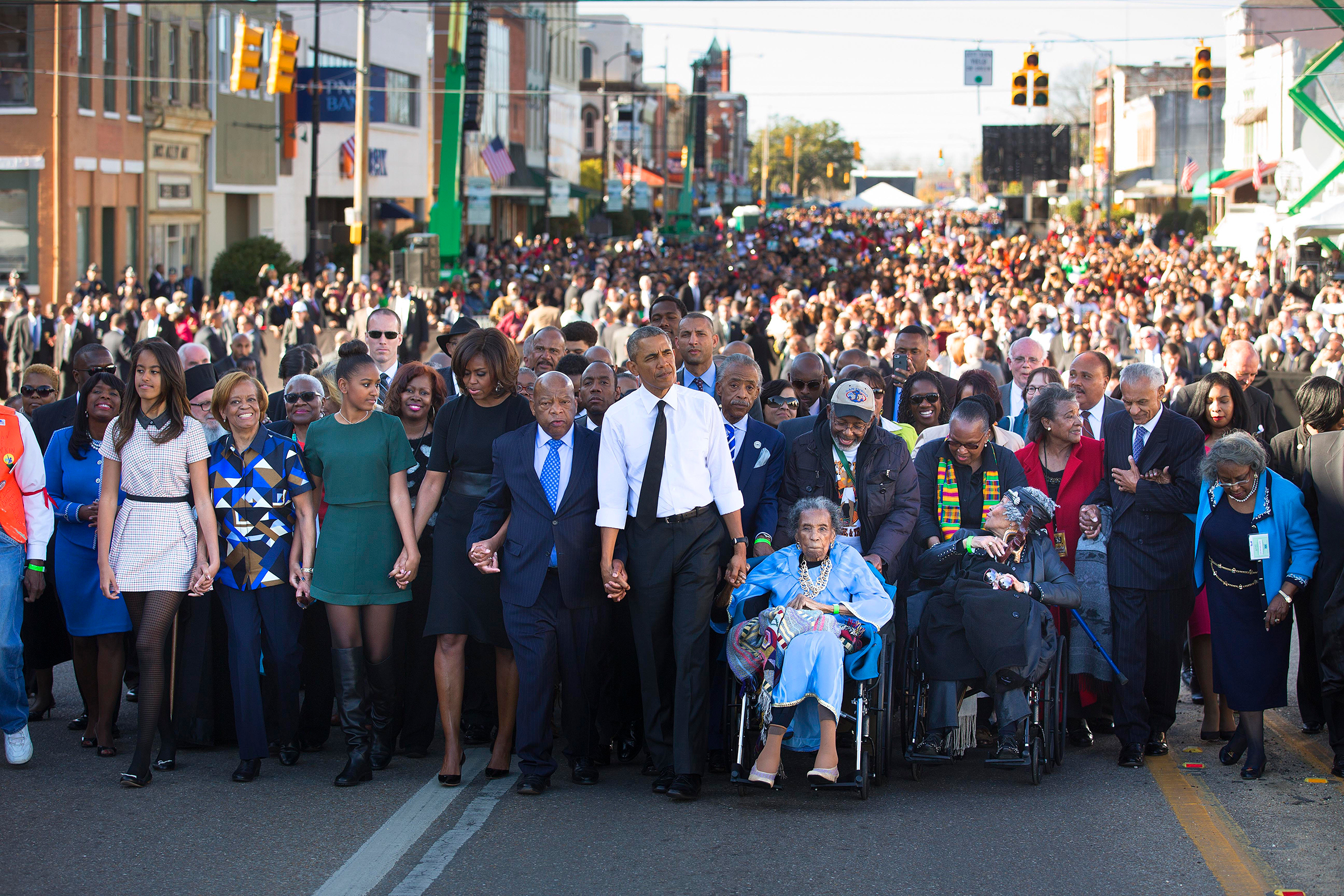Barack Obama, Amelia Boynton, right, Rep. John Lewis and the President's family lead a march toward the Edmund Pettus Bridge in Selma, Ala., on March 7, 2015, 50 years after  Bloody Sunday.