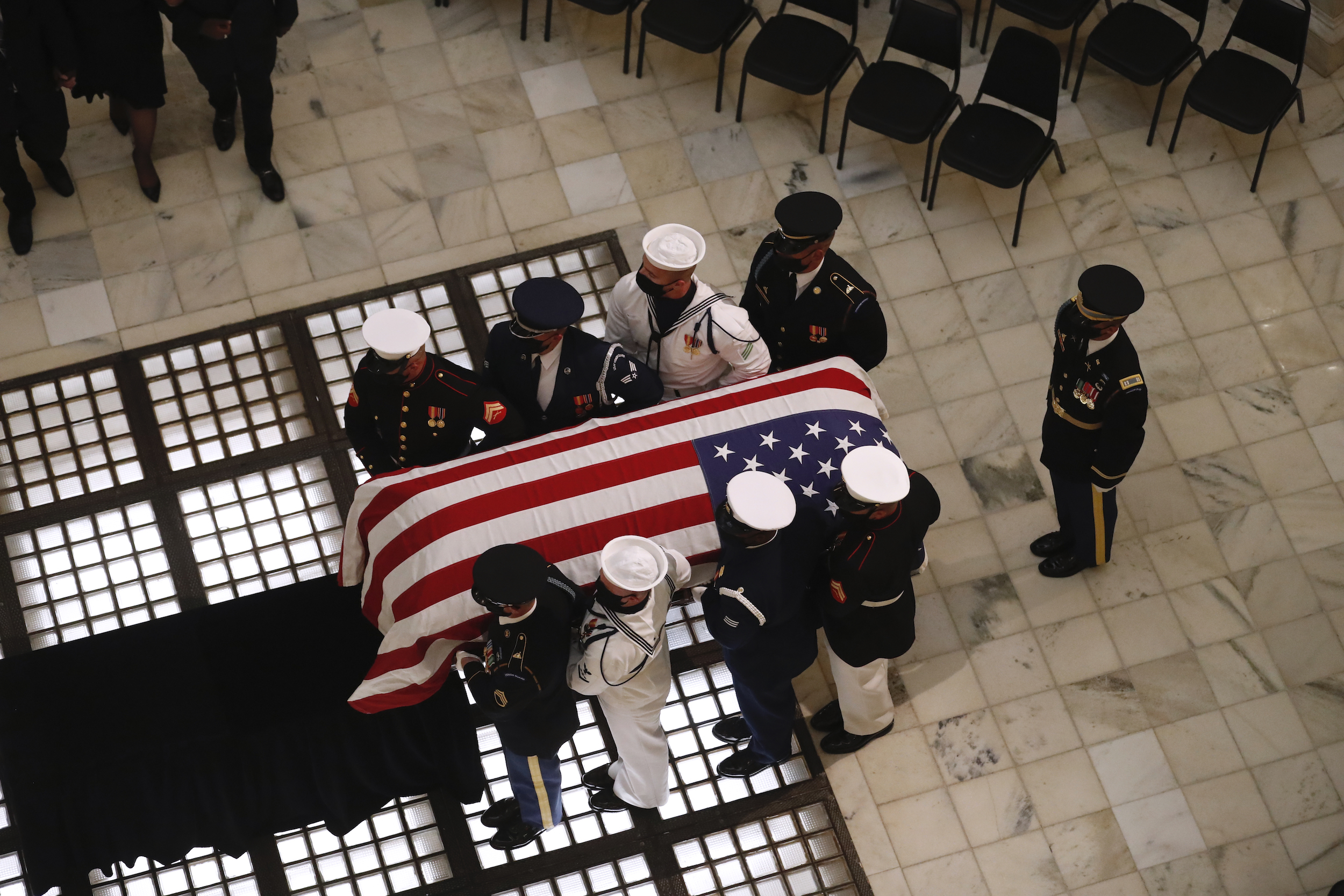 A military honor guard moves with the casket of Rep. John Lewis at the state capital on July 29, 2020, in Atlanta.