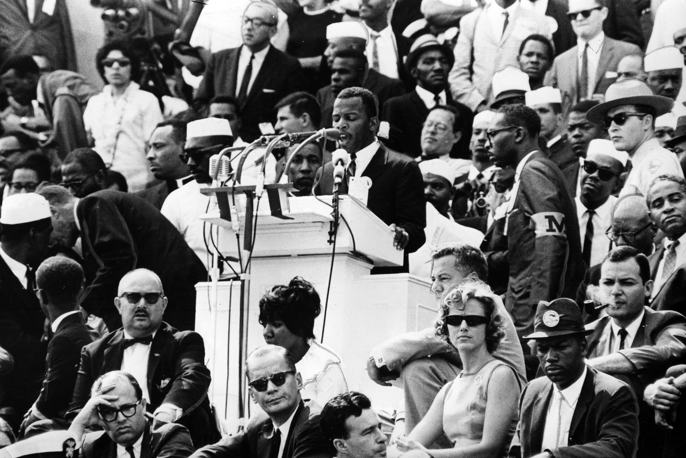 John Lewis of the Student Nonviolent Coordinating Committee addresses a crowd at the 1963 March on Washington.