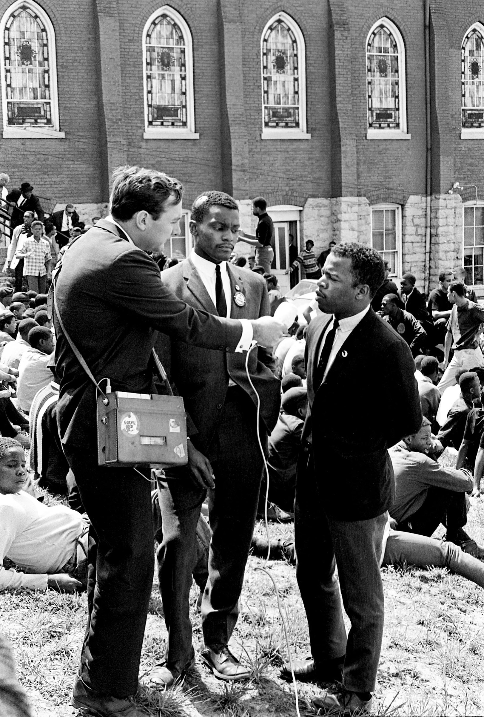 John Lewis, right, and Lester McKinnie, center, are interviewed by ABC News at the sit-in demonstrators' base at the First Baptist Church in Nashville on April 30, 1964.