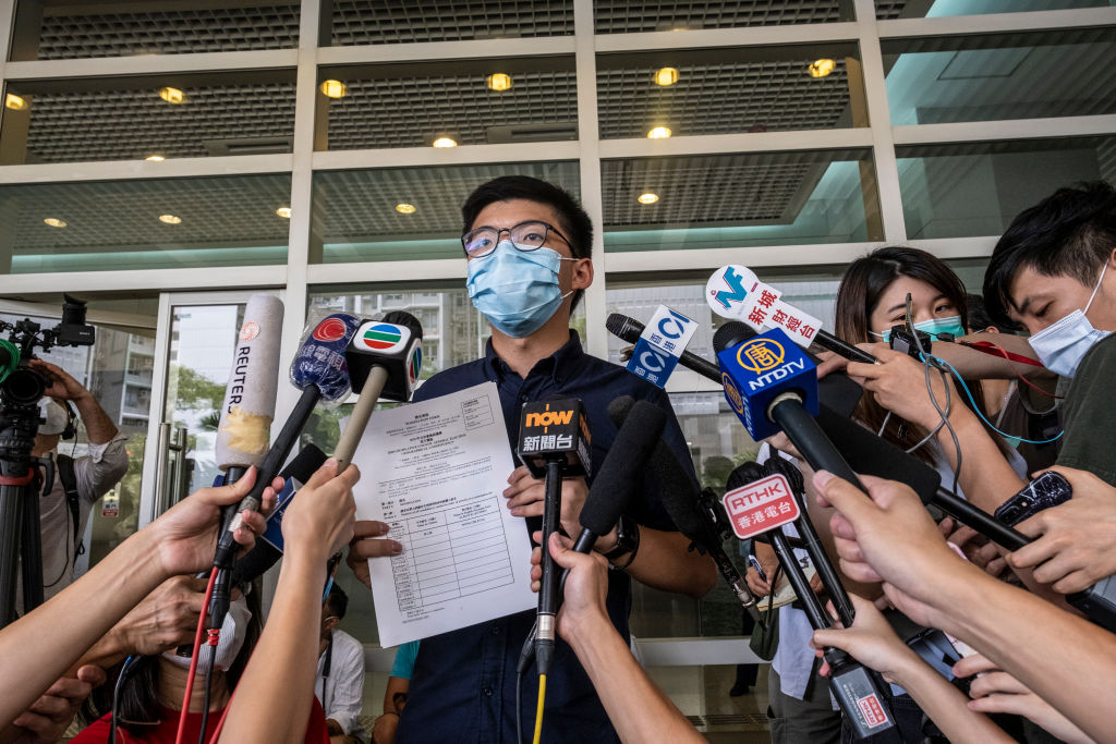 Joshua Wong holds his application for his run in the 2020 Legislative Council Election during a press conference in Hong Kong on July 20, 2020.