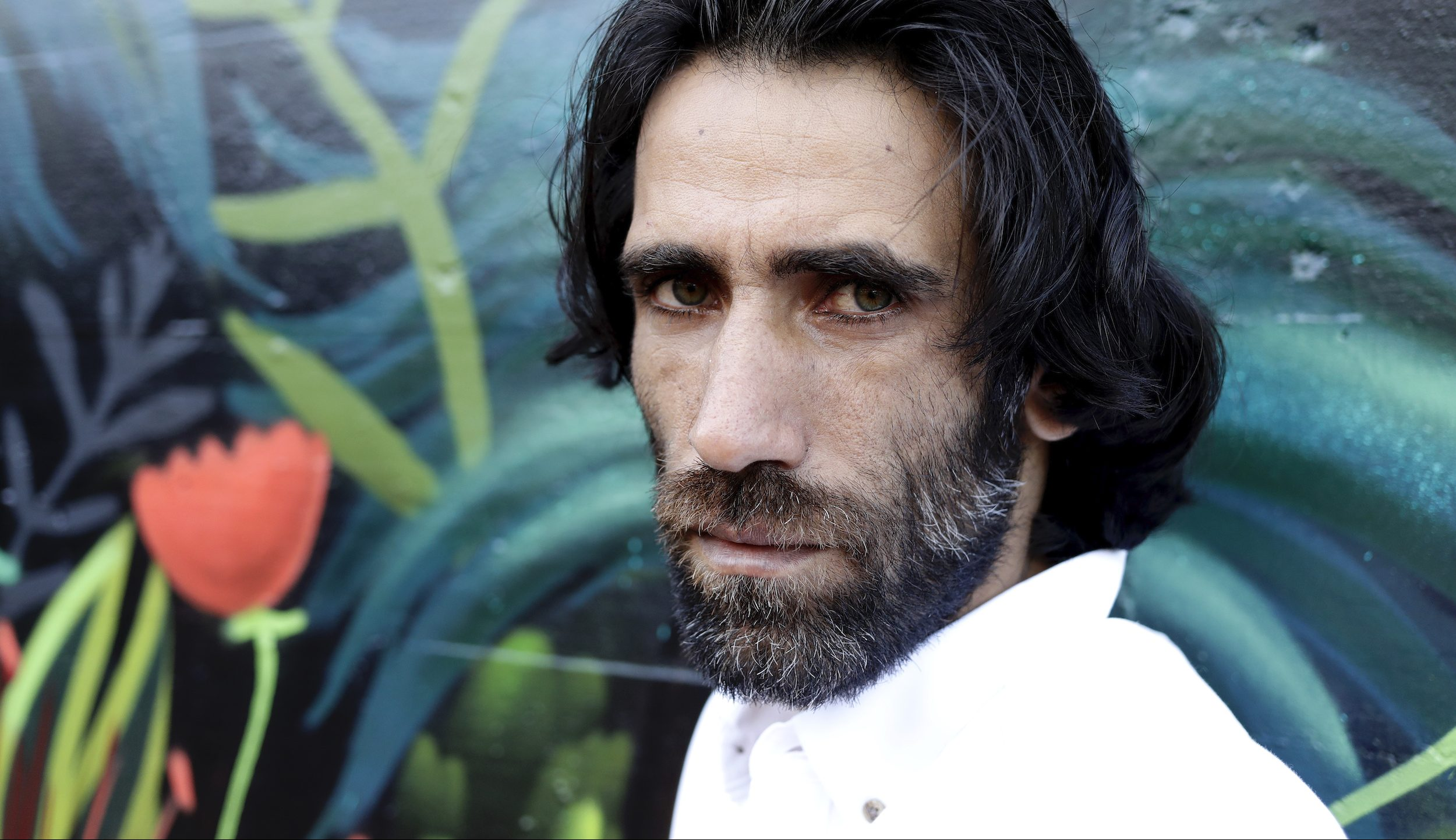 Behrouz Boochani, the Kurdish film-maker, writer and refugee who has documented life inside the Australian detention centre on Manus Island, poses for a portrait in Christchurch, New Zealand on Nov. 19, 2019.