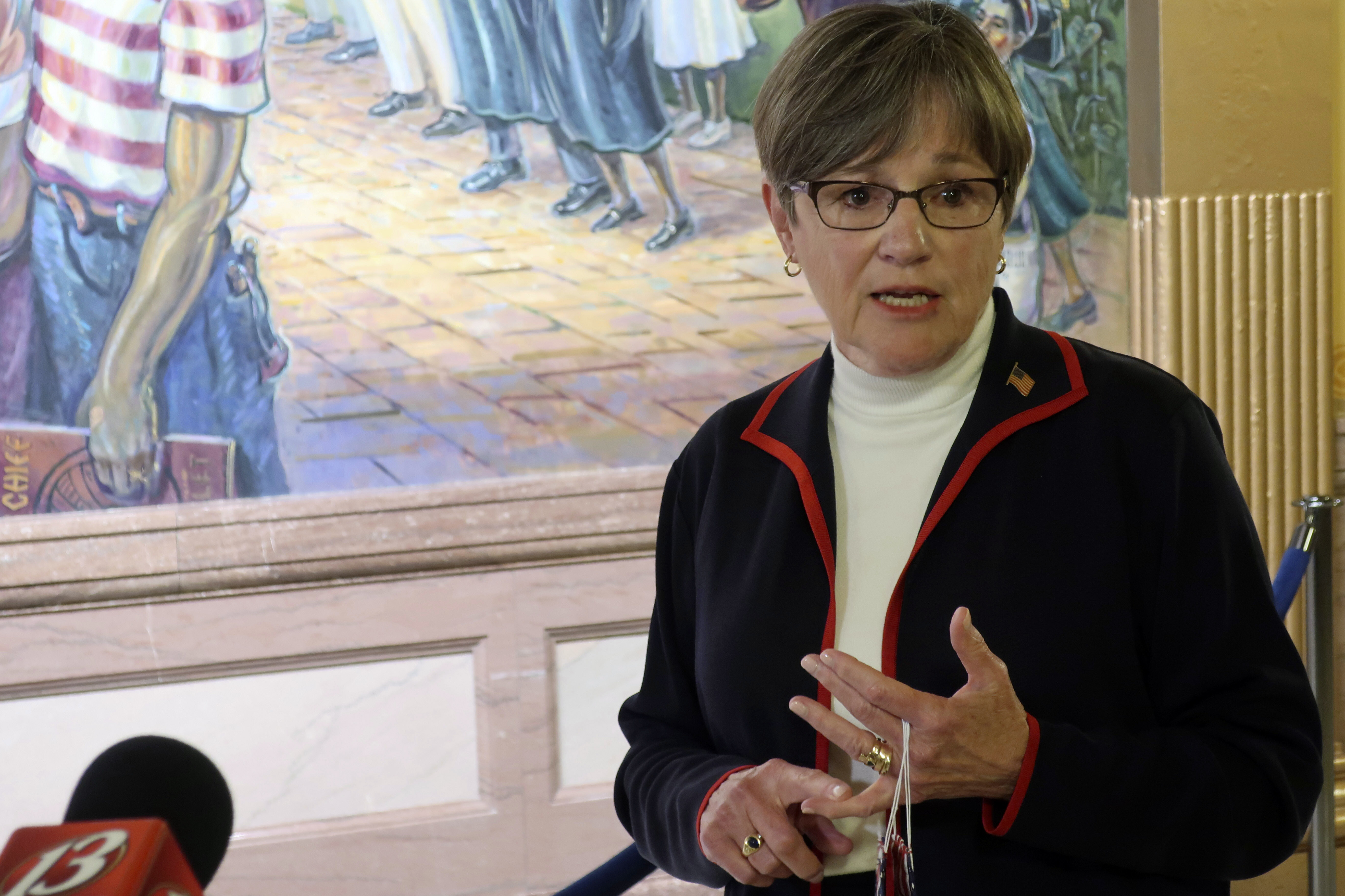 Kansas Gov. Laura Kelly answers questions from reporters about the coronavirus pandemic after a meeting with legislative leaders, Thursday, July 2, 2020, at the Statehouse in Topeka, Kan. Kelly has issued an order to require people to wear masks in public and at their workplaces.