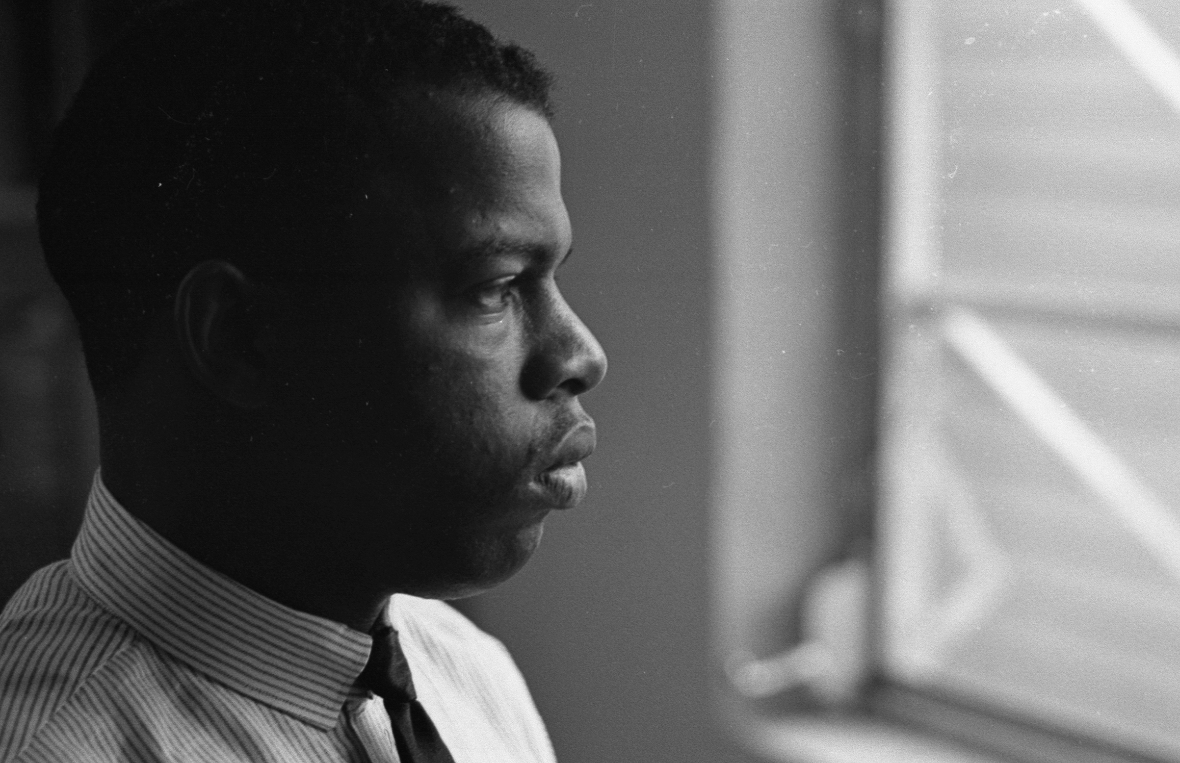 American Civil Rights activist (and future politician) John Lewis, chairman of the Student Non-Violent Coordinating Committee (SNCC), in an office in New York City, 1964.