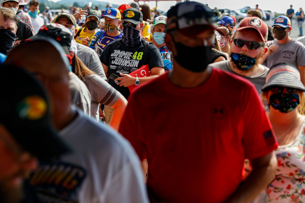 Fans wearing face masks and face coverings enter the race track prior to the NASCAR Cup Series All-Star Race at Bristol Motor Speedway on July 15, 2020 in Bristol, Tennessee.