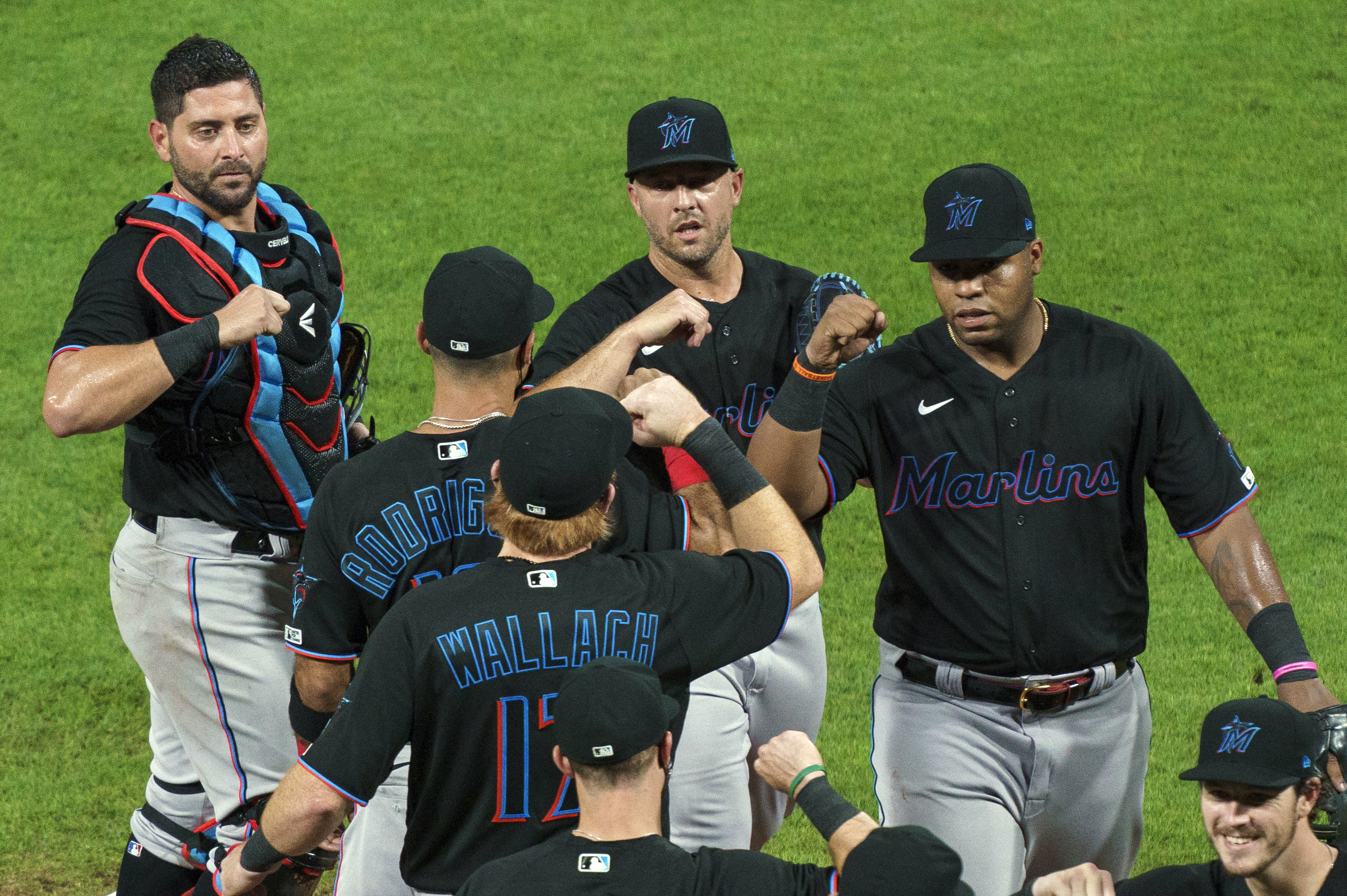 Miami Marlins' Jesus Aguilar, right, celebrates a 5-2 win with teammates following a baseball game against the Philadelphia Phillies in Philadelphia on July 24, 2020
