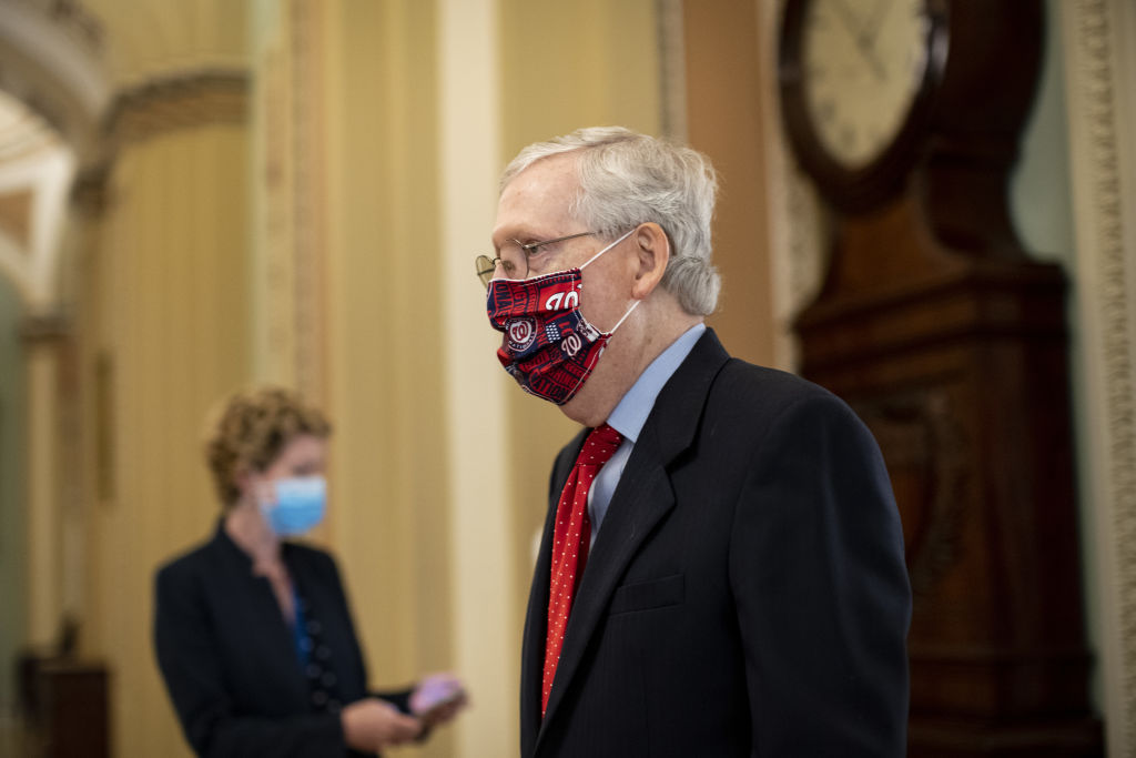 Senate Majority Leader Mitch McConnell, a Republican from Kentucky, wears a protective mask while walking to the Senate floor at the U.S. Capitol in Washington, D.C., U.S., on Thursday, July 30, 2020.