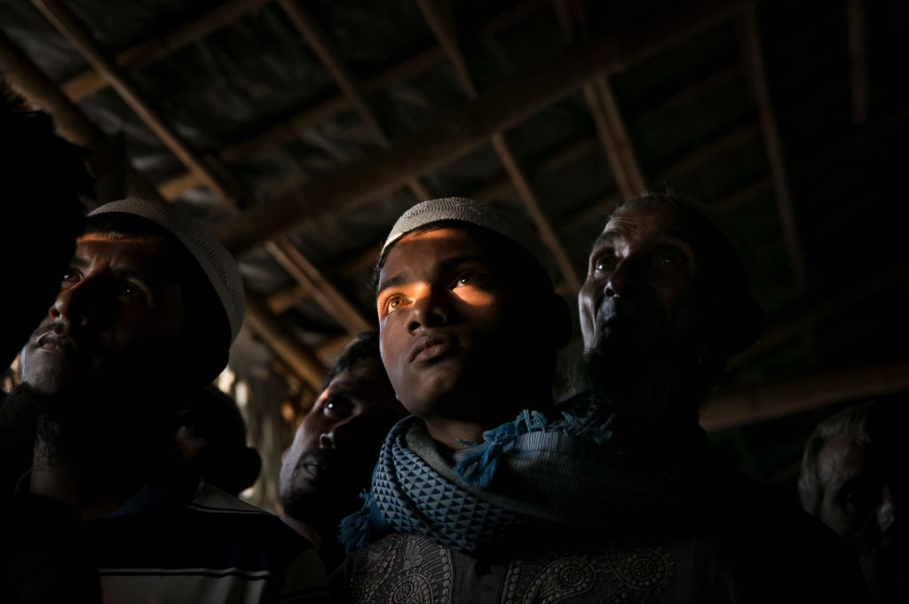 Rohingya refugees watch televised proceedings at the U.N.'s International Court of Justice from a refugee camp in Cox's Bazar, Bangladesh Dec. 12, 2019.