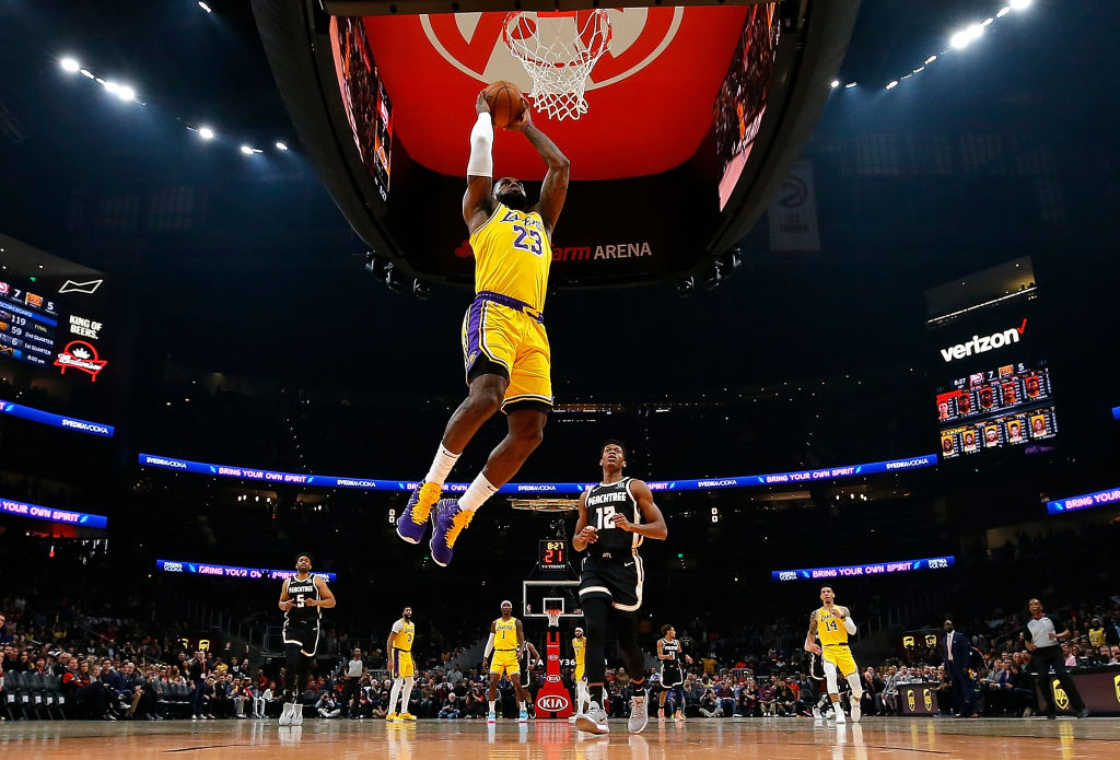 LeBron James #23 of the Los Angeles Lakers dunks against the Atlanta Hawks in the first half at State Farm Arena on December 15, 2019 in Atlanta, Georgia.